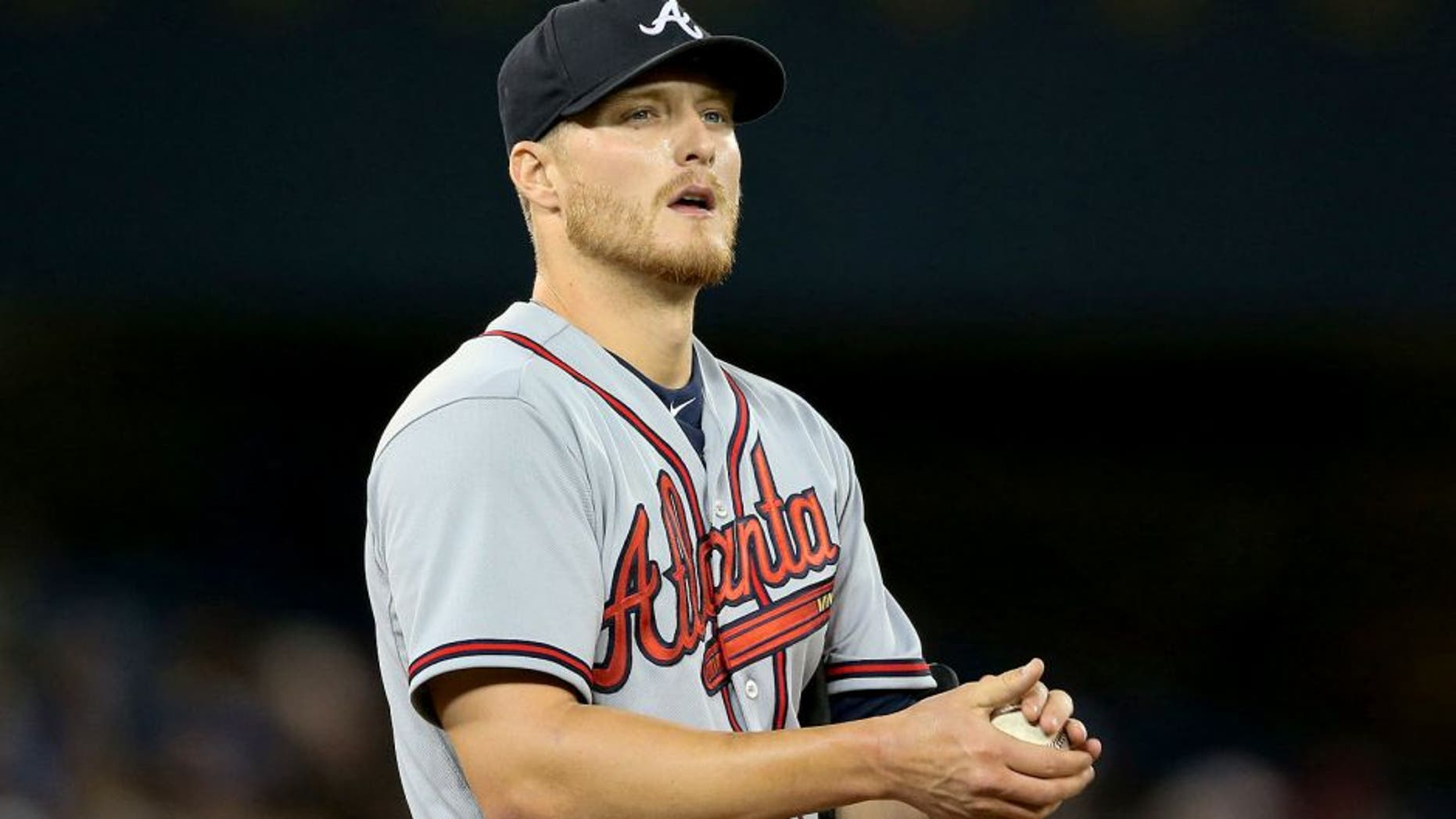 TORONTO, CANADA - APRIL 19: Shelby Miller #17 of the Atlanta Braves rubs up a baseball in the sixth inning during MLB game action against the Toronto Blue Jays on April 19, 2015 at Rogers Centre in Toronto, Ontario, Canada. (Photo by Tom Szczerbowski/Getty Images)