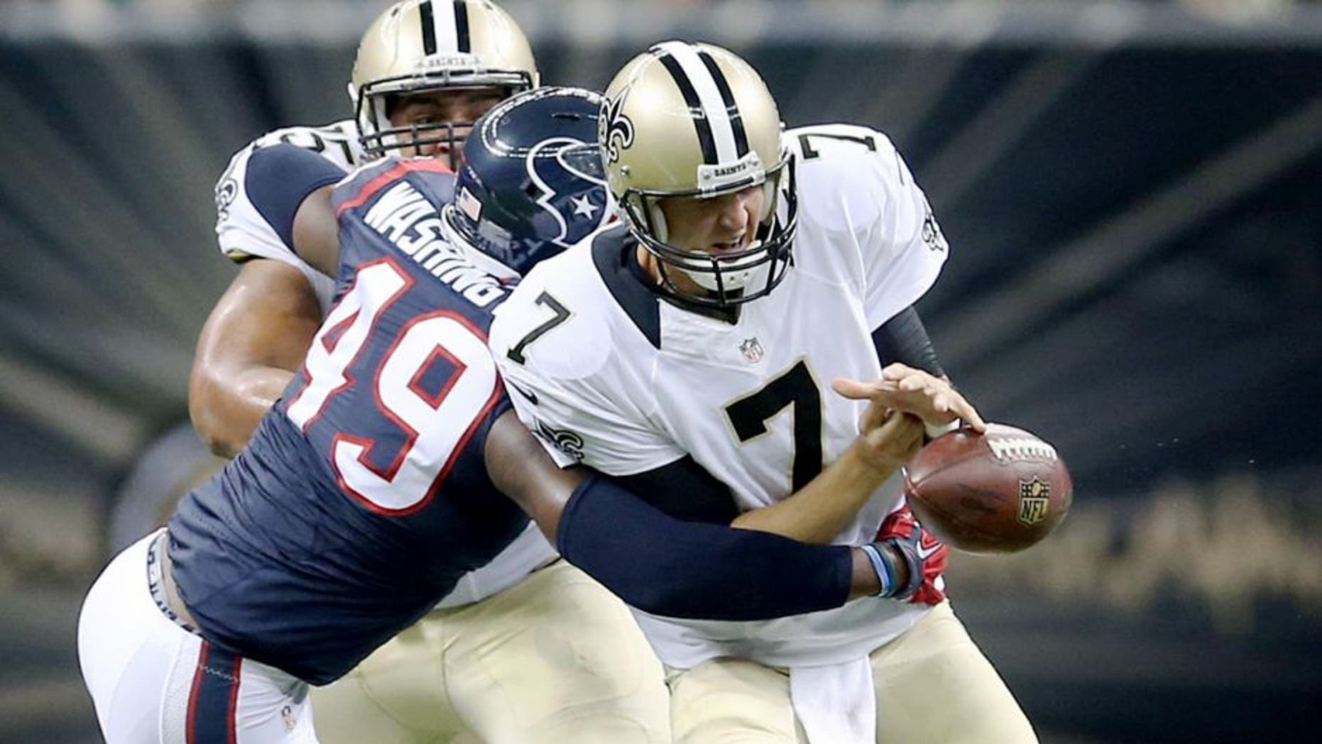 Aug 30, 2015; New Orleans, LA, USA; Houston Texans outside linebacker Tony Washington (49) knocks the football away from New Orleans Saints quarterback Luke McCown (7) in the second quarter of their game at the Mercedes-Benz Superdome. Mandatory Credit: Chuck Cook-USA TODAY Sports