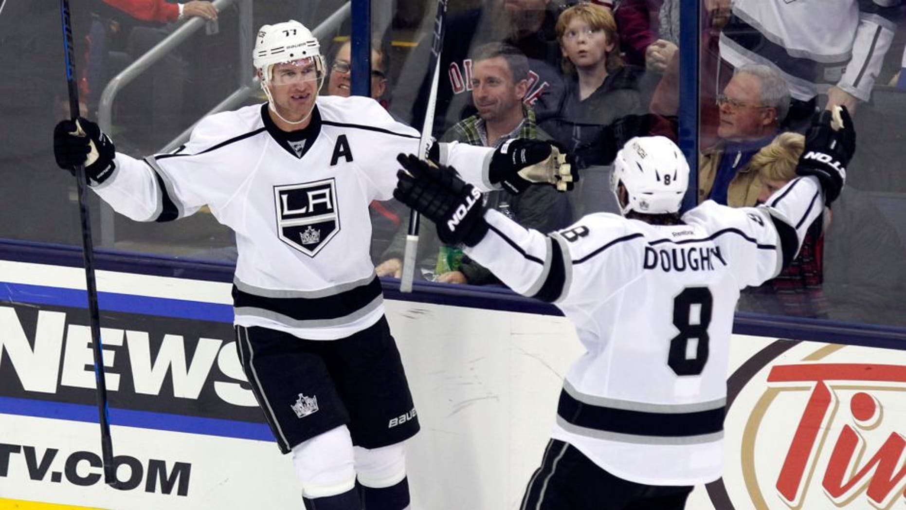 Los Angeles Kings' Jeff Carter, left, celebrates his goal against the Columbus Blue Jackets with teammate Drew Doughty during the third period of an NHL hockey game in Columbus, Ohio, Tuesday, Dec. 8, 2015. Los Angeles won 3-2 in overtime. (AP Photo/Paul Vernon)