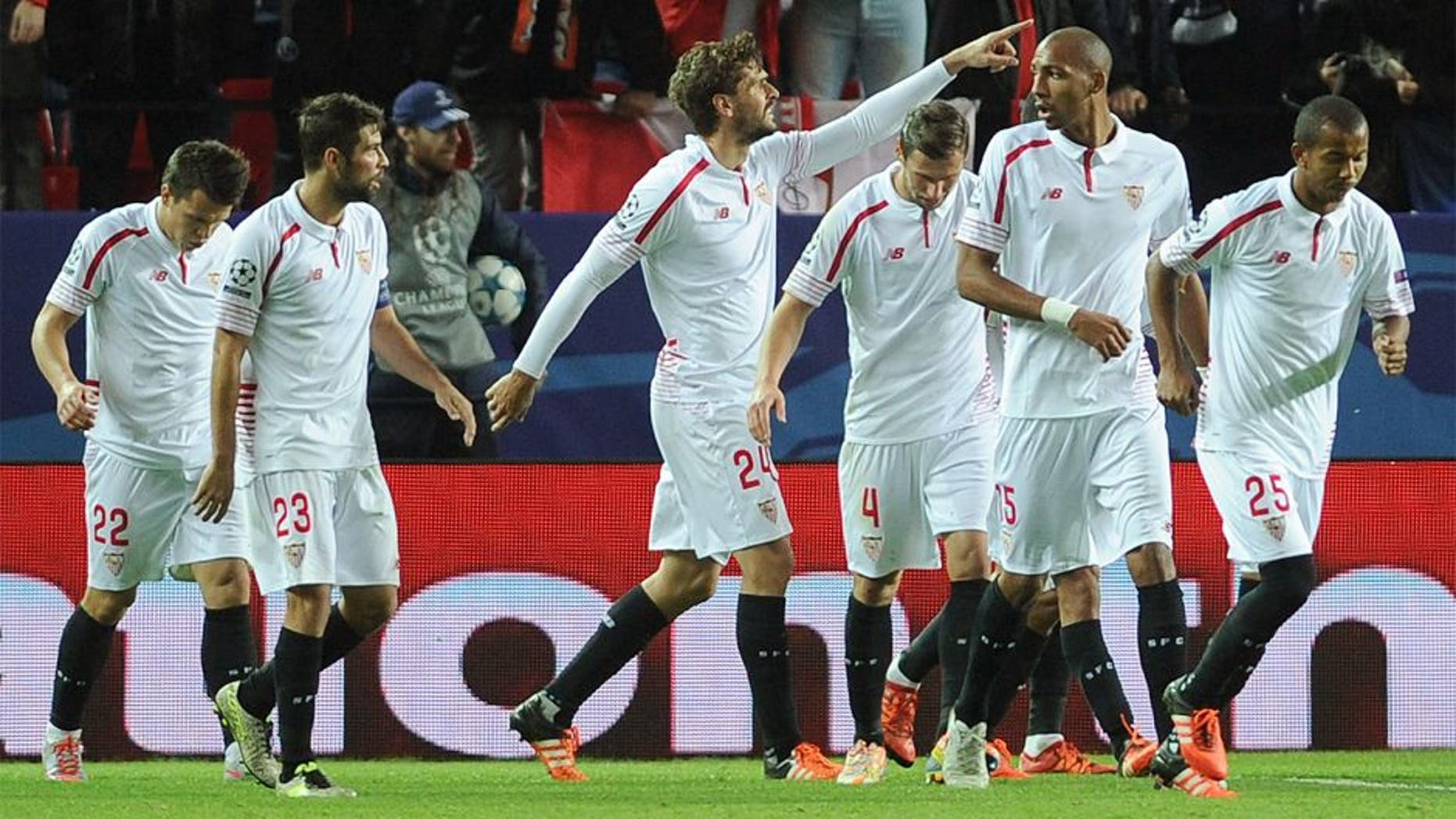 Sevilla's Spanish forward Fernando Llorente (C) celebrates with teammates after scoring a goal during the UEFA Champions League Group D football match Sevilla FC vs Juventus at the Ramon Sanchez Pizjuan stadium in Sevilla on December 8, 2015. AFP PHOTO/ CRISTINA QUICLER / AFP / CRISTINA QUICLER (Photo credit should read CRISTINA QUICLER/AFP/Getty Images)