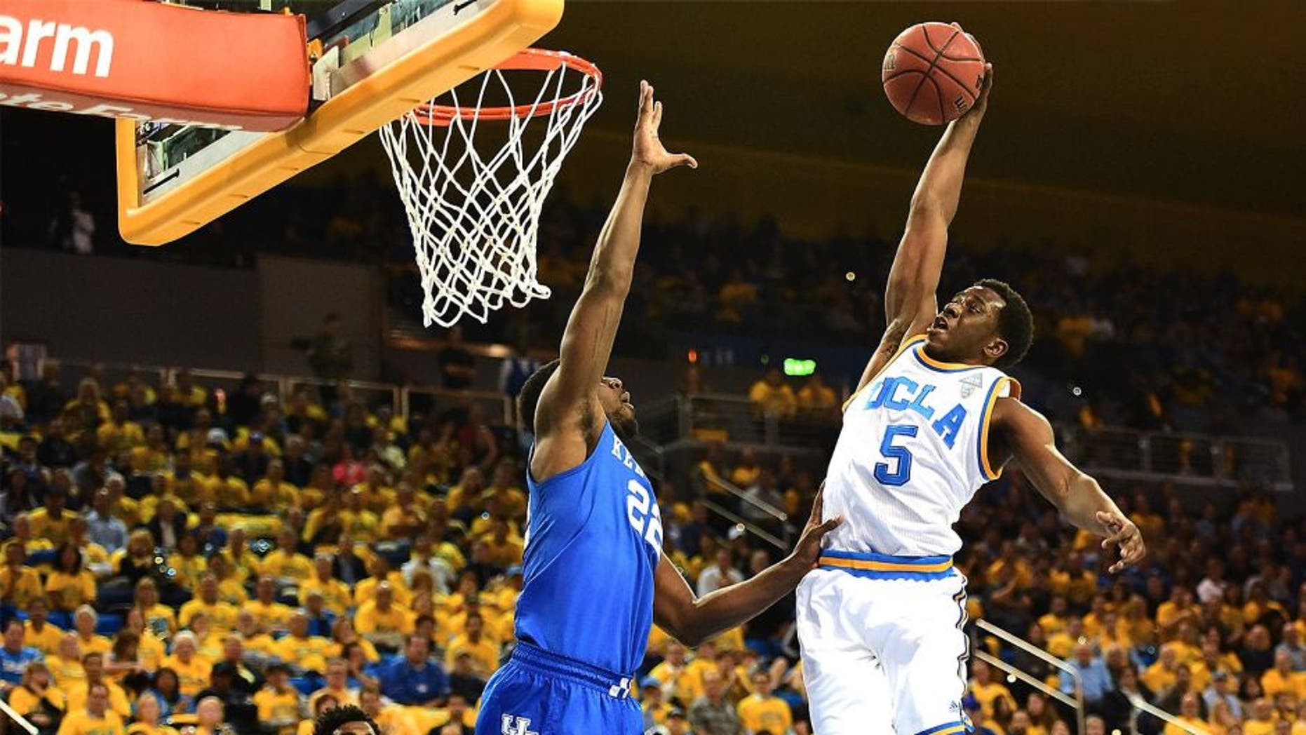 LOS ANGELES, CA - DECEMBER 03: Prince Ali #5 of the UCLA Bruins dunks over Alex Poythress #22 of the Kentucky Wildcats during an 87-77 UCLA win at Pauley Pavilion on December 3, 2015 in Los Angeles, California. (Photo by Harry How/Getty Images)