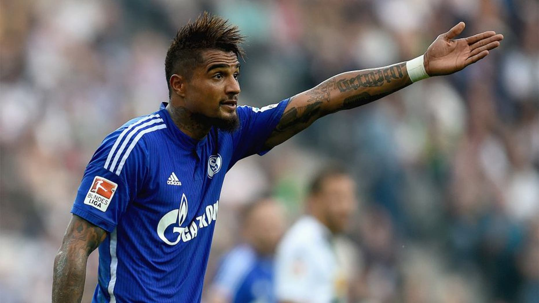 MOENCHENGLADBACH, GERMANY - SEPTEMBER 13: Kevin Prince-Boateng of FC Schalke 04 reacts during the Bundesliga match between Borussia Moenchengladbach and FC Schalke 04 at Borussia Park Stadium on September 13, 2014 in Moenchengladbach, Germany. (Photo by Dennis Grombkowski/Bongarts/Getty Images)