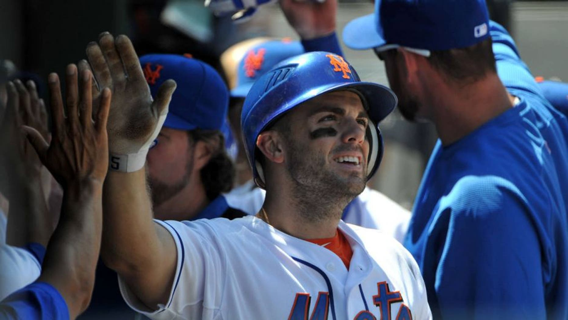 NEW YORK, NY - AUGUST 11: David Wright #5 of the New York Mets is congratulated after scoring on a double by Lucas Duda #21 of the New York Mets (not pictured) in the bottom of the third inning against the San Diego Padres at Citi Field on August 11, 2011 in the Flushing neighborhood of the Queens borough of New York City. (Photo by Christopher Pasatieri/Getty Images)