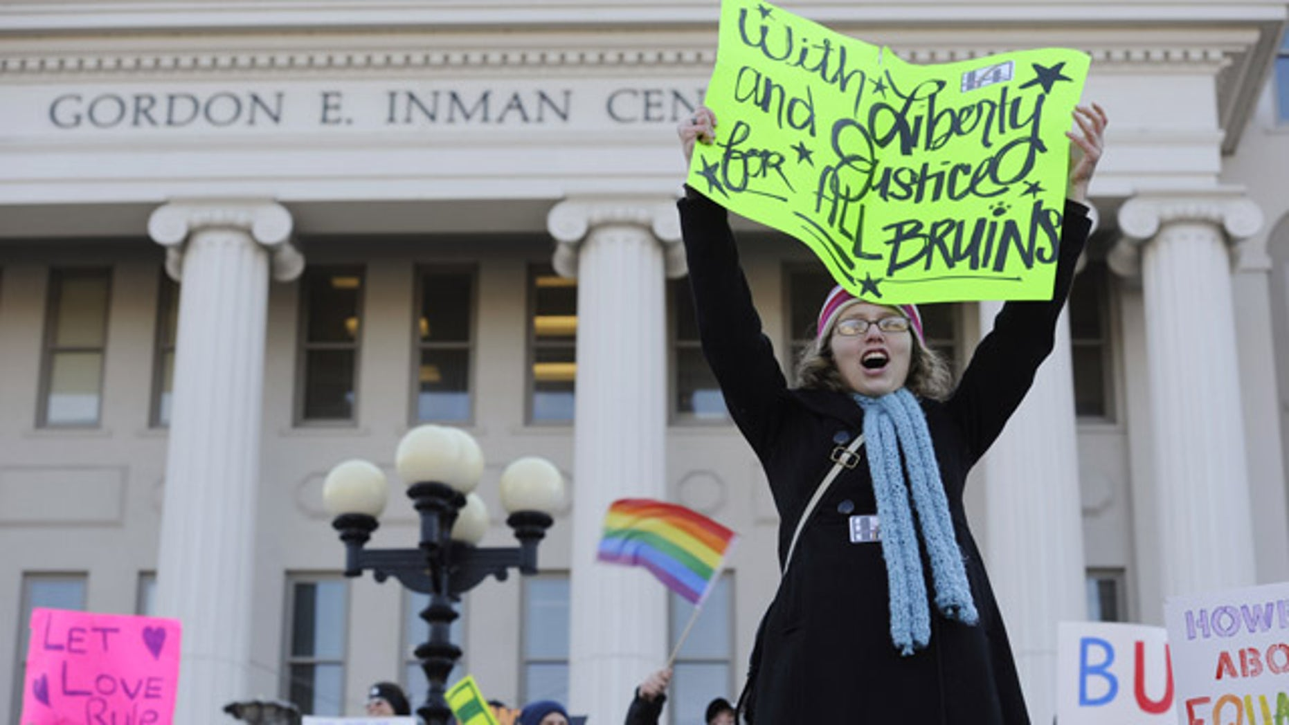 Dec. 8: Belmont University senior Lindsey Thompson holds up a sign during rally in support of former women's soccer coach Lisa Howe, at the university in Nashville, Tenn.