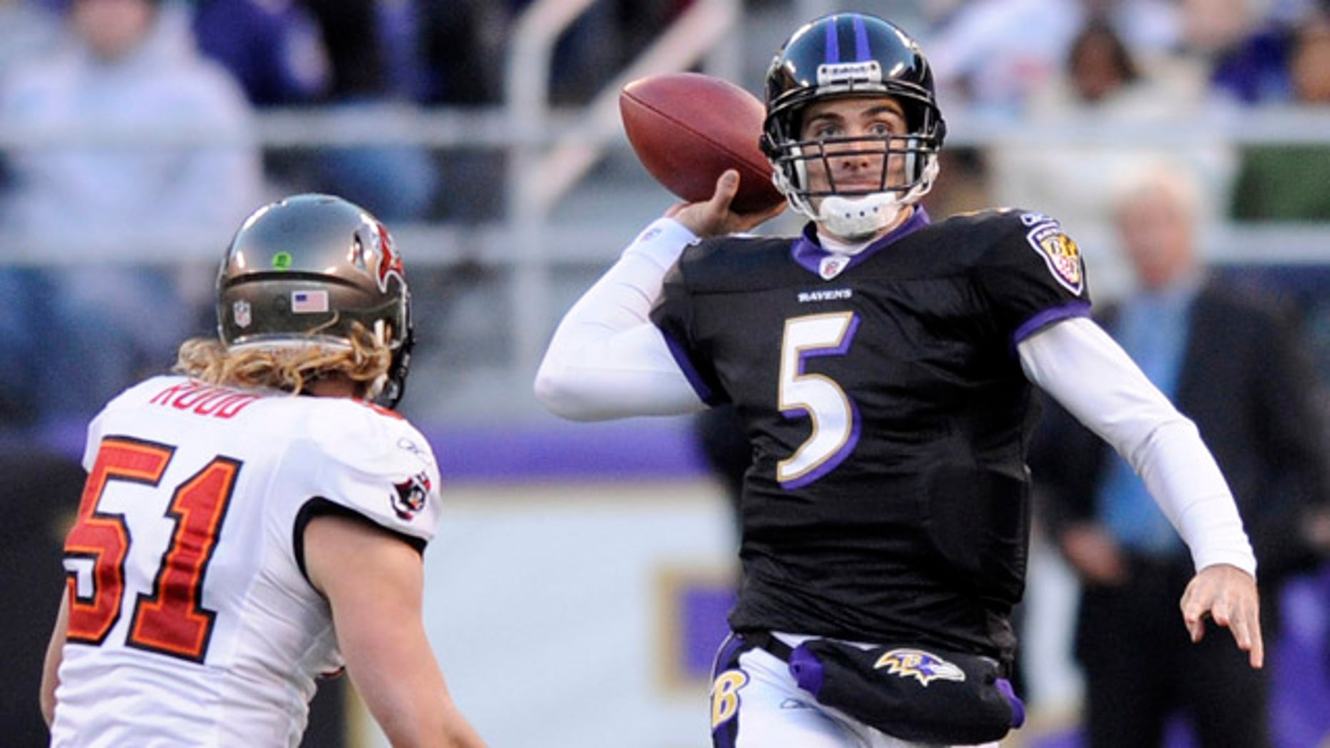 Nov. 28: Baltimore Ravens quarterback Joe Flacco (5) throws a pass while being pressured byTampa Bay Buccaneers linebacker Barrett Ruud (51) during the first half of an NFL football game in Baltimore.