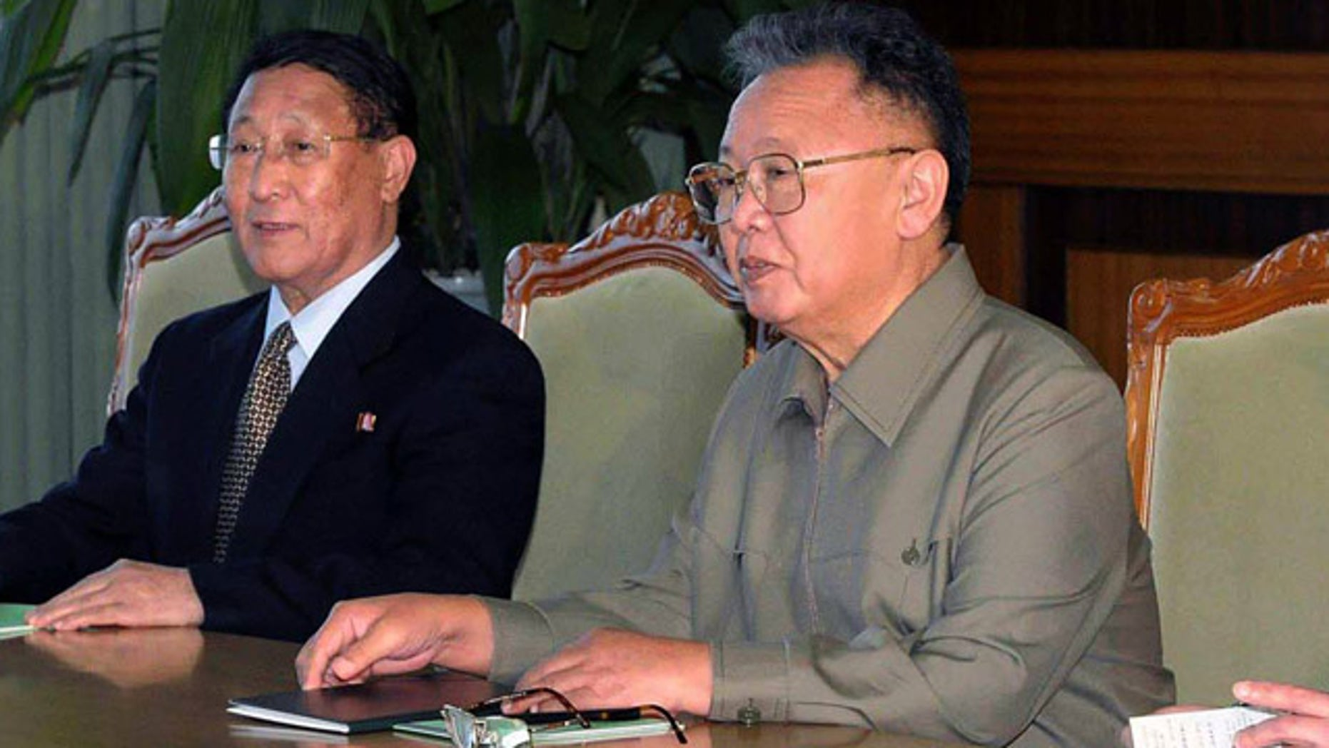 Dec. 9: In this photo released by Korean Central News Agency via Korea News Service in Tokyo, North Korean leader Kim Jong Il, right, holds a talk with Chinese State Councilor Dai Bingguo, unseen, during a meeting in Pyongyang, North Korea.