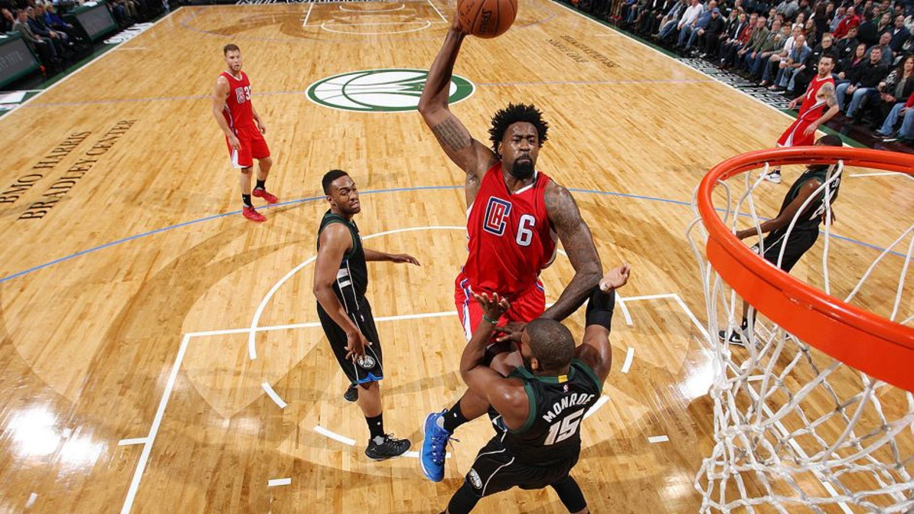 Milwaukee, WI - DECEMBER 9: DeAndre Jordan #6 of the Los Angeles Clippers goes up for a dunk against Greg Monroe #15 of the Milwaukee Bucks on December 9, 2015 at the BMO Harris Bradley Center in Milwaukee, Wisconsin. NOTE TO USER: User expressly acknowledges and agrees that, by downloading and or using this Photograph, user is consenting to the terms and conditions of the Getty Images License Agreement. Mandatory Copyright Notice: Copyright 2015 NBAE (Photo by Gary Dineen/NBAE via Getty Images)