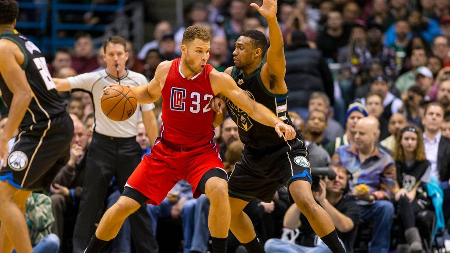 Dec 9, 2015; Milwaukee, WI, USA; Los Angeles Clippers forward Blake Griffin (32) drives for the basket as Milwaukee Bucks forward Jabari Parker (12) defends during the fourth quarter at BMO Harris Bradley Center. The Clippers won 109-95. Mandatory Credit: Jeff Hanisch-USA TODAY Sports