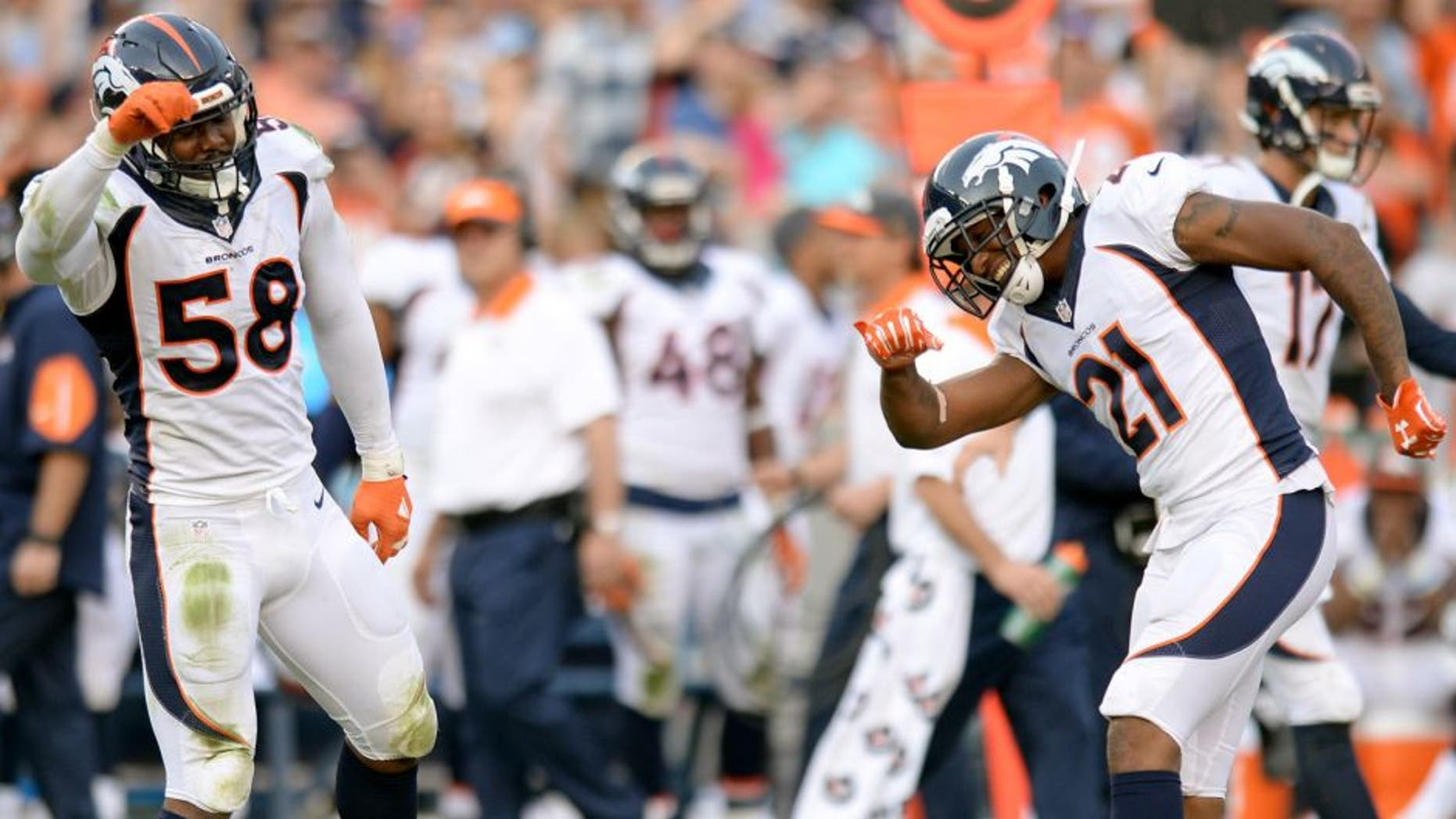 Dec 6, 2015; San Diego, CA, USA; Denver Broncos outside linebacker Von Miller (58) and cornerback Aqib Talib (21) celebrate after a defensive stop during the fourth quarter against the San Diego Chargers at Qualcomm Stadium. Mandatory Credit: Jake Roth-USA TODAY Sports
