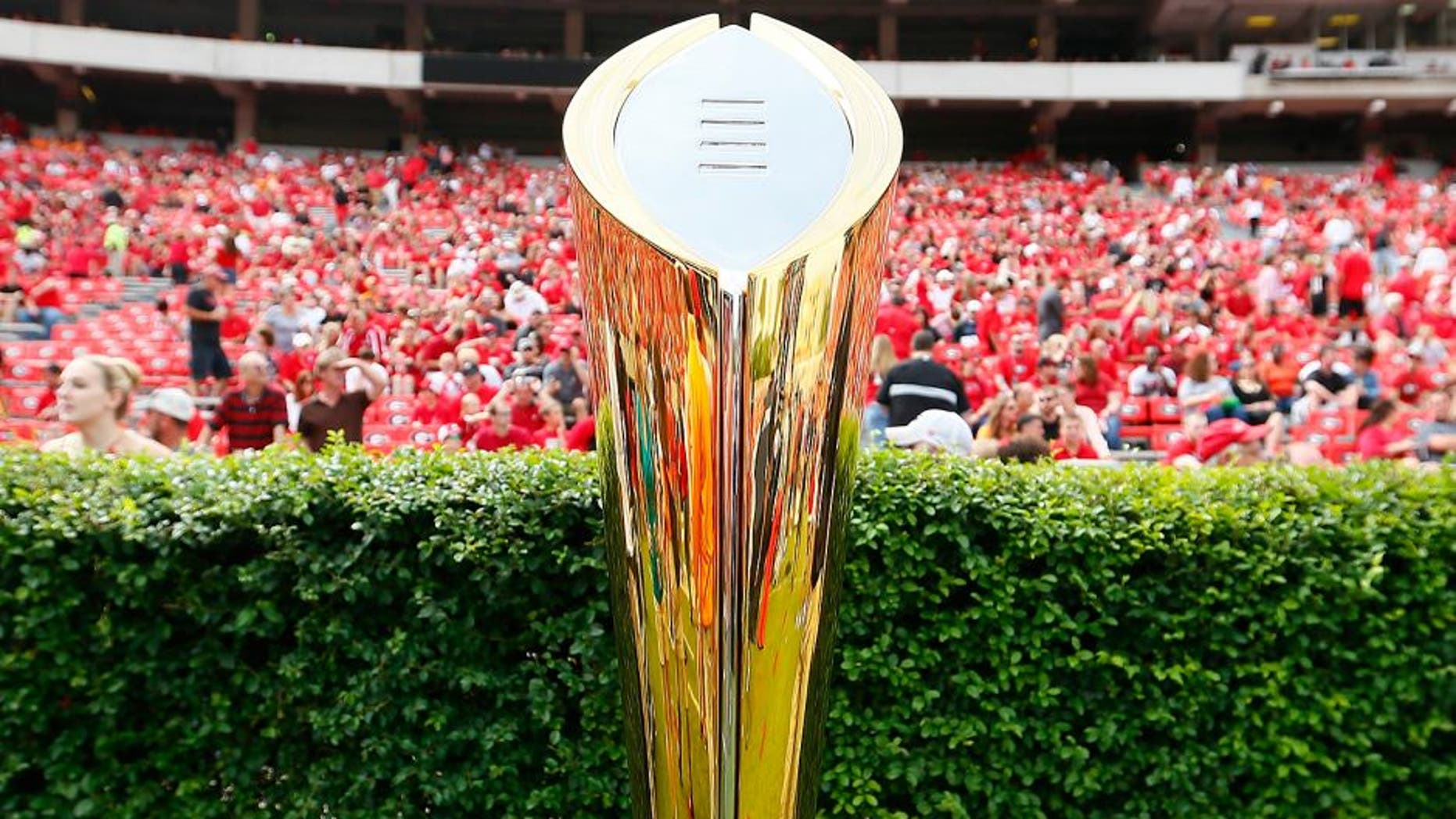 ATHENS, GA - SEPTEMBER 27: The College Football Playoff National Championship Trophy is seen on the field prior to the game between the Georgia Bulldogs and the Tennessee Volunteers at Sanford Stadium on September 27, 2014 in Athens, Georgia. (Photo by Kevin C. Cox/Getty Images)