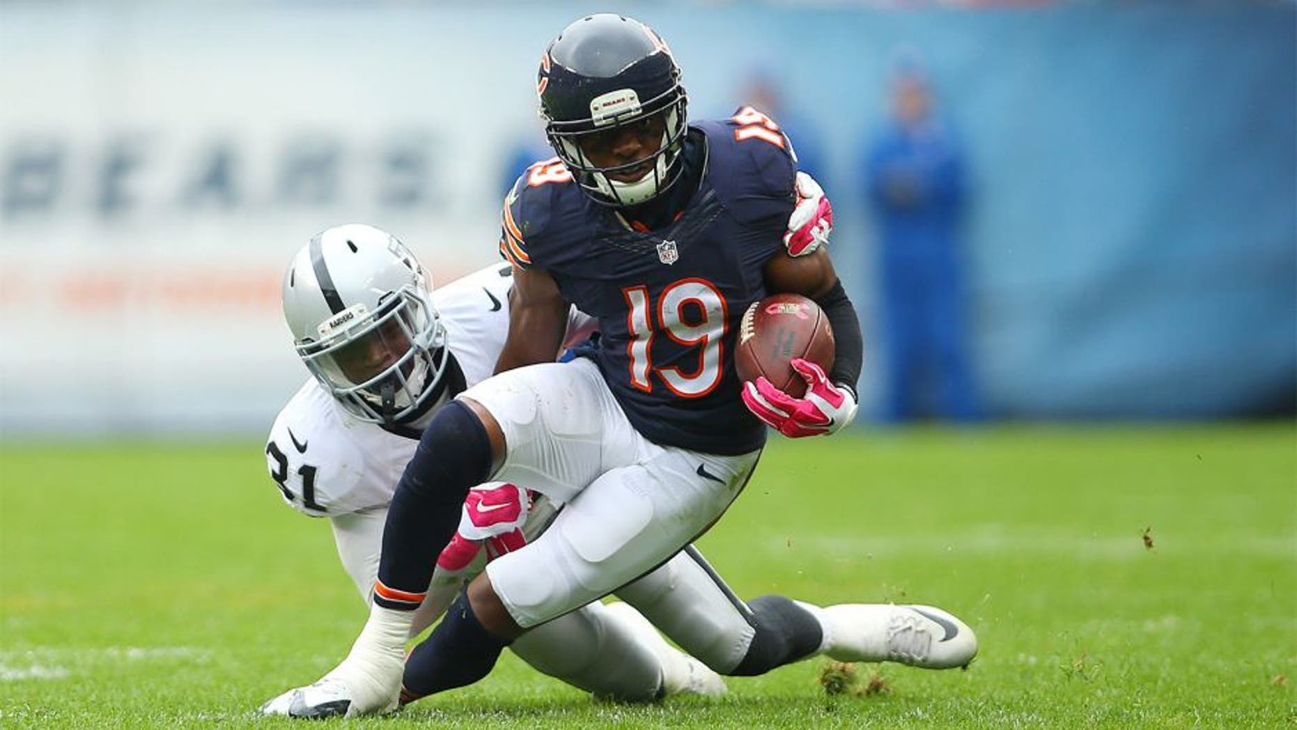 Oct 4, 2015; Chicago, IL, USA; Chicago Bears wide receiver Eddie Royal (19) is tackled by Oakland Raiders cornerback Neiko Thorpe (31) during the second half at Soldier Field. Mandatory Credit: Jerry Lai-USA TODAY Sports