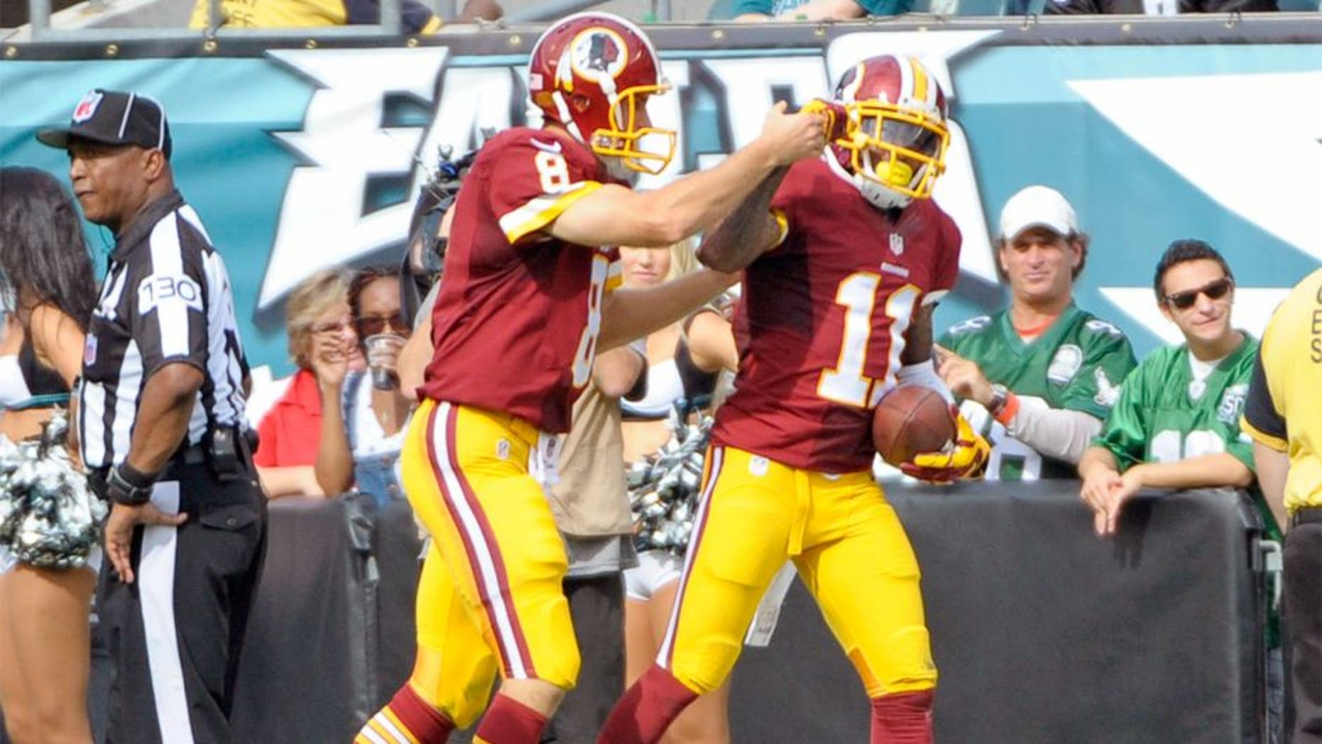 Sep 21, 2014; Philadelphia, PA, USA; Washington Redskins quarterback Kirk Cousins (8) and wide receiver DeSean Jackson (11) celebrate 81-yard touchdown catch in the third quarter against the Philadelphia Eagles at Lincoln Financial Field. The Eagles defeated the Redskins, 37-34. Mandatory Credit: Eric Hartline-USA TODAY Sports