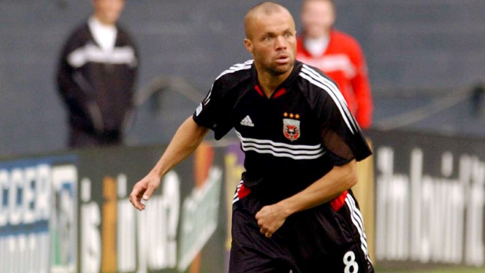 Earnie Stewart #8 of D.C. United looks to kick the ball against the San Jose Earthquakes in Washington D.C. on April 3, 2004. D.C. United defeated the Earthquakes 2-1. (Photo by Joe Murphy/MLSNETImages)