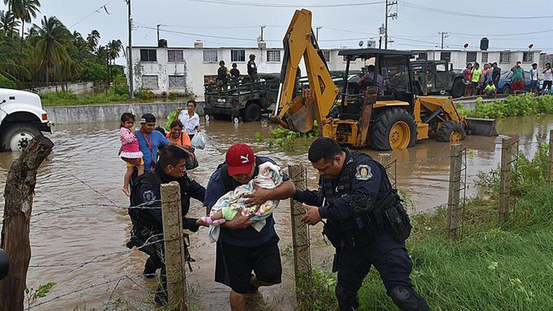 A handout photo released by Mexican news agency Quadratin shows people being evacuated by members Guerrero State Police after floods due heavy rains in the state of Guerrero, Mexico, 04 September 2016. EFE