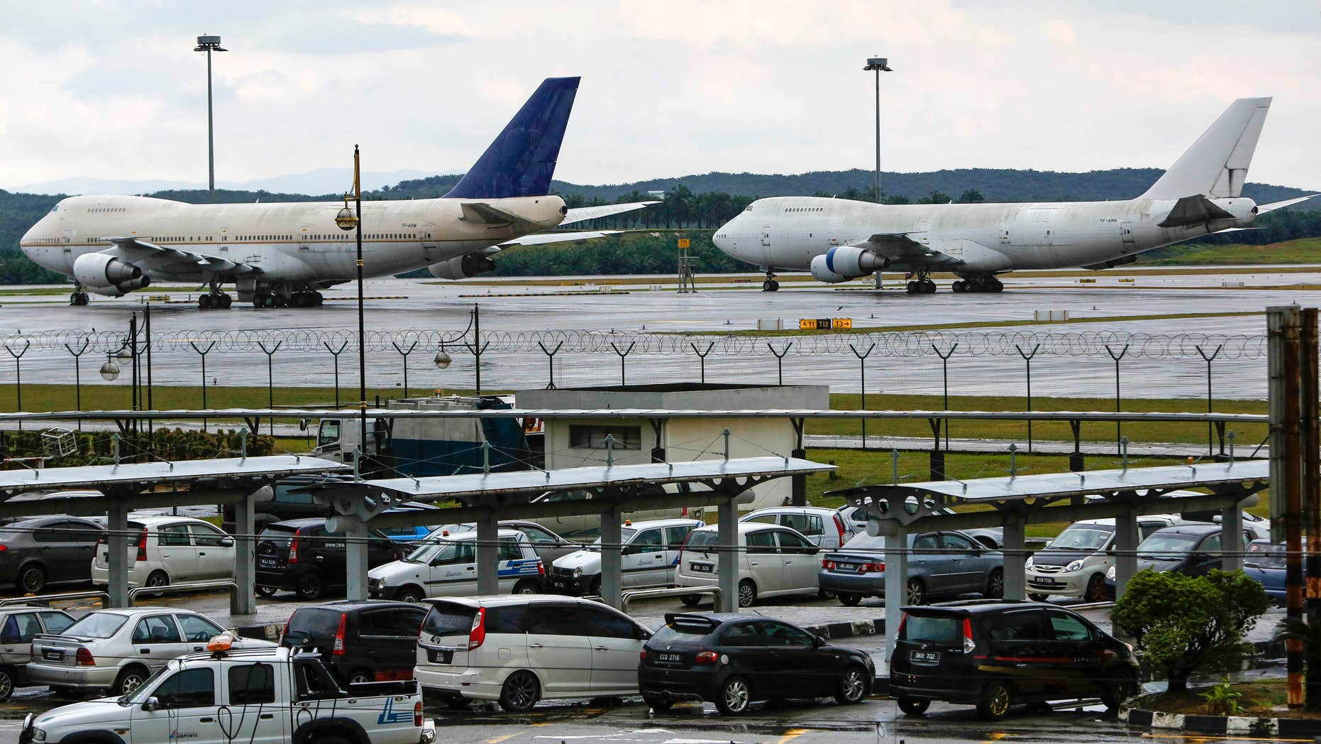 Dec. 9, 2015: Left to right, two of the three abandoned planes with tail numbers, TF-ARM and TF-ARN are seen taxied on the tarmac of Kuala Lumpur International Airport in Sepang, Malaysia.