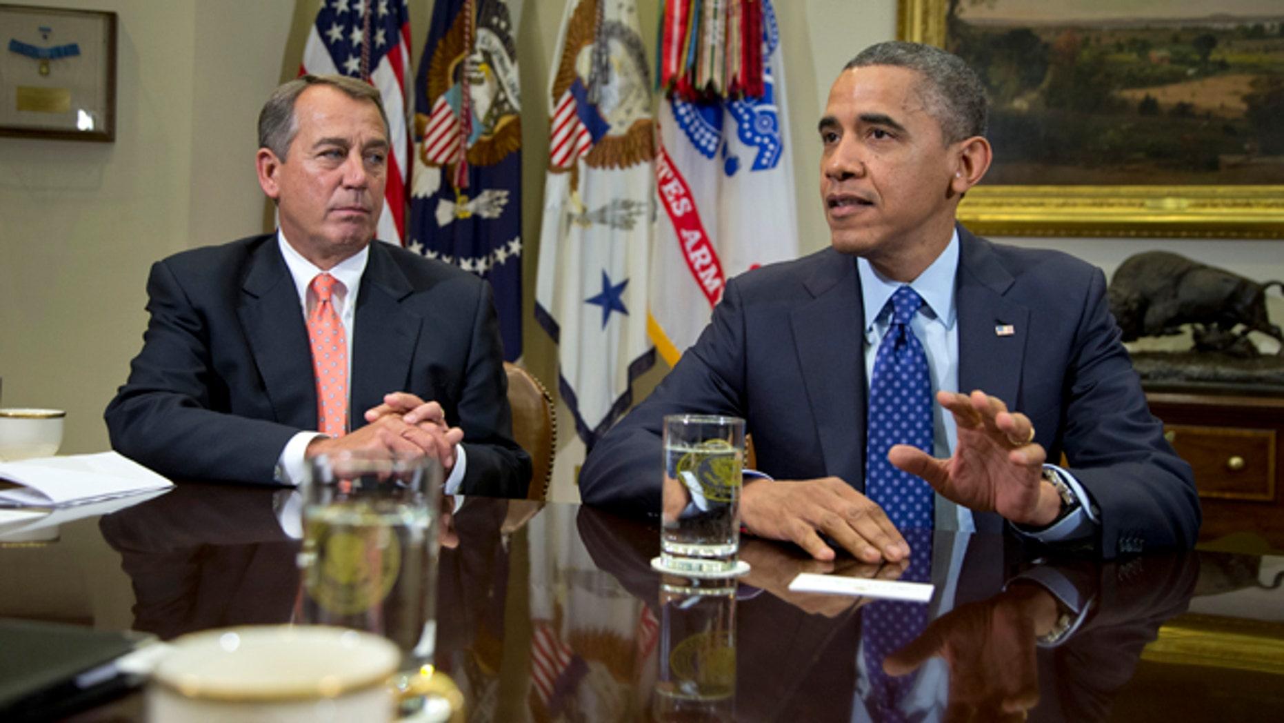 Nov. 16, 2012: President Barack Obama, accompanied by House Speaker John Boehner of Ohio, speaks to reporters in the Roosevelt Room of the White House in Washington.