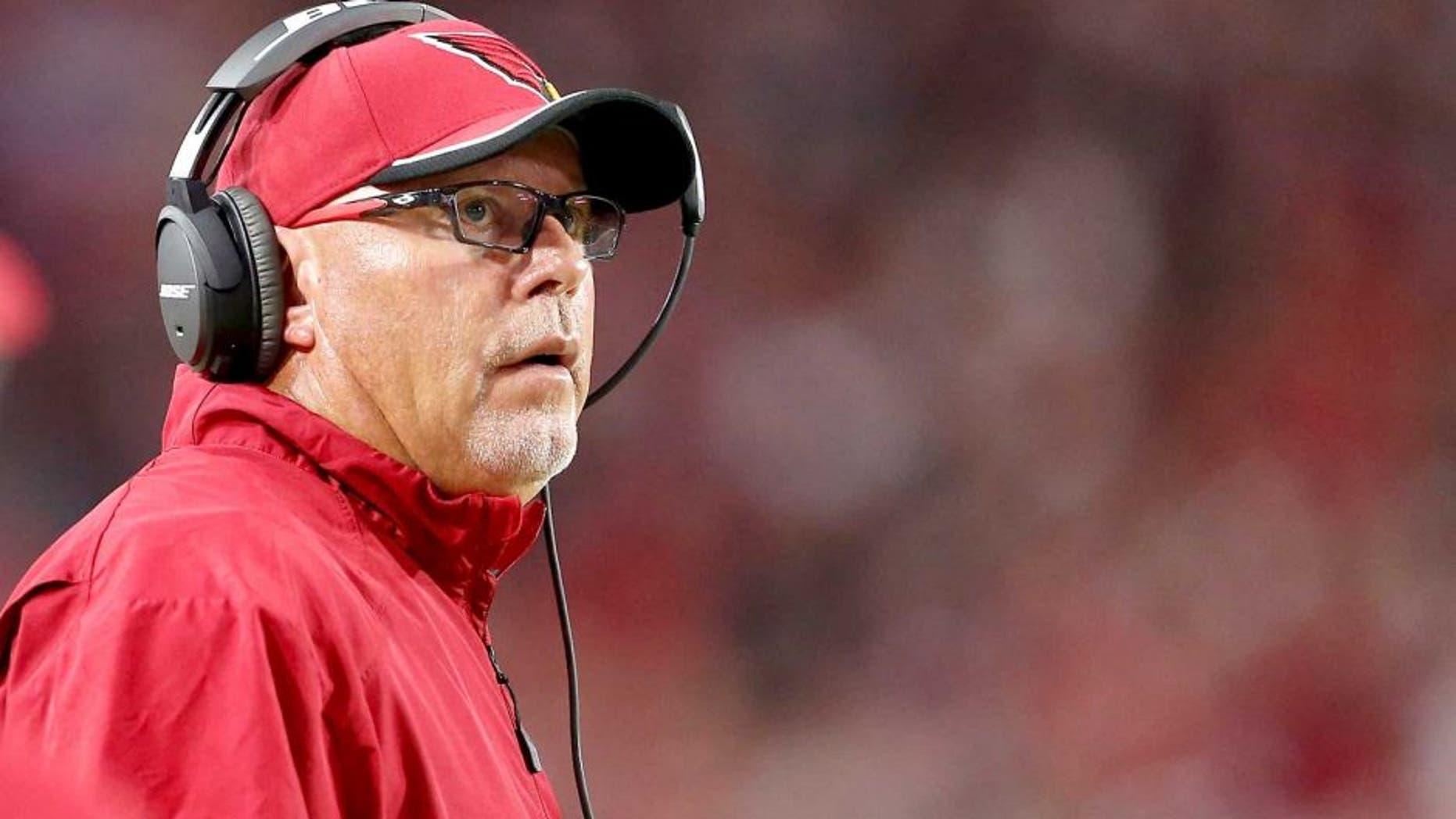 GLENDALE, AZ - DECEMBER 07: Head coach Bruce Arians of the Arizona Cardinals looks up to the video board during the NFL game against the Kansas City Chiefs at the University of Phoenix Stadium on December 7, 2014 in Glendale, Arizona. The Cardinals defeated the Chiefs 17-14. (Photo by Christian Petersen/Getty Images)