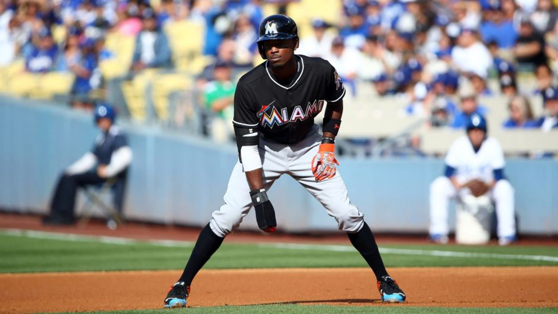 LOS ANGELES, CA - MAY 13: Dee Gordon #9 of the Miami Marlins leads off at first in the first inning during the MLB game against the Los Angeles Dodgers at Dodger Stadium on May 13, 2015 in Los Angeles, California. The Marlins defeated the Dodgers 5-4. (Photo by Victor Decolongon/Getty Images)