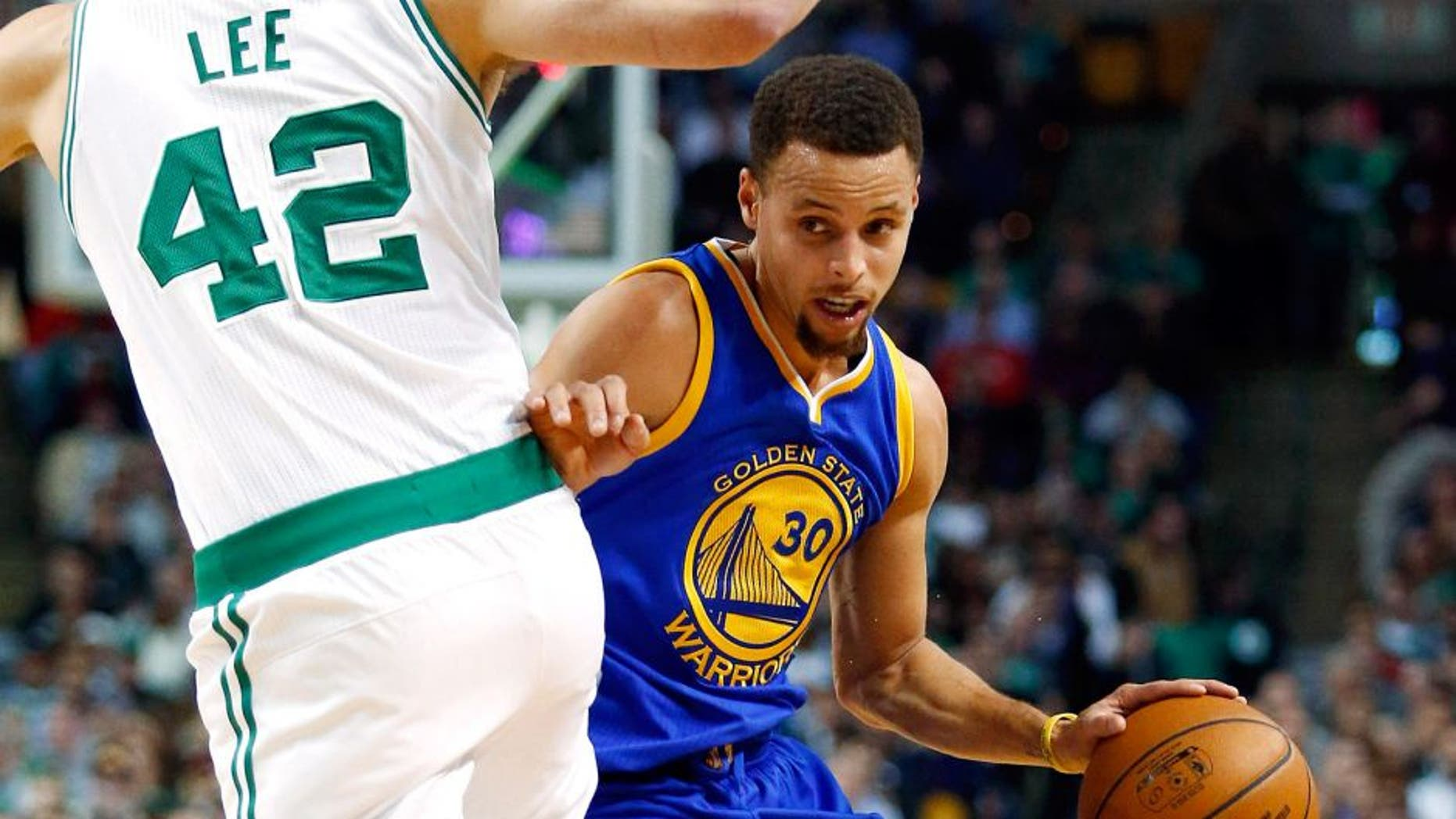 Dec 11, 2015; Boston, MA, USA; Golden State Warriors guard Stephen Curry (30) tries to get around Boston Celtics forward David Lee (42) during the first half at TD Garden. Mandatory Credit: Winslow Townson-USA TODAY Sports