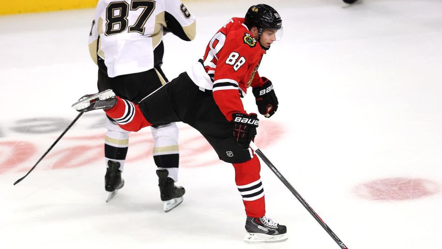 CHICAGO, IL - SEPTEMBER 19: Patrick Kane #88 of the Chicago Blackhawks leaps to avoid colliding with Sidney Crosby #87 of the Pittsburgh Penguins during an exhibition game at United Center on September 19, 2013 in Chicago, Illinois. The Penguins defeated the Blackhawks 4-3 in a shootout. (Photo by Jonathan Daniel/Getty Images)