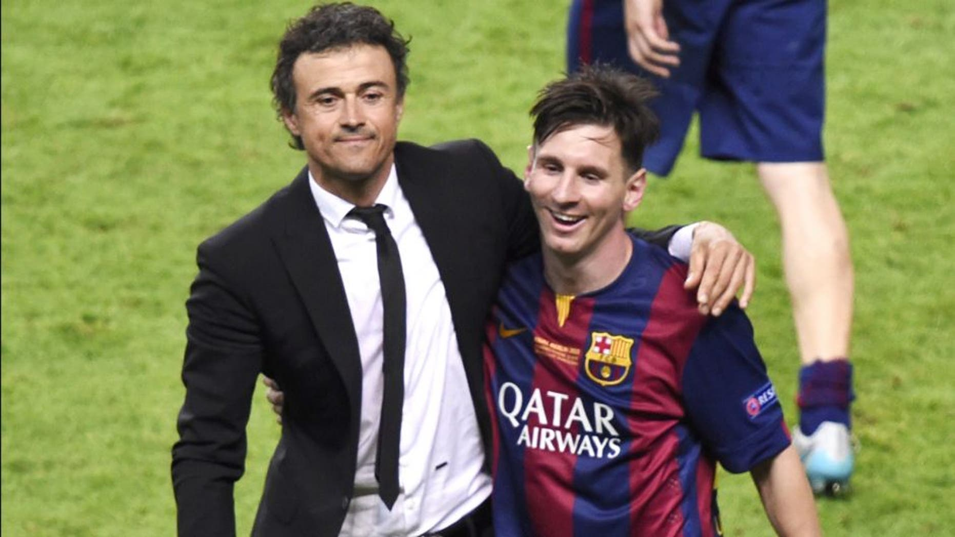 Barcelona's coach Luis Enrique (L) and Barcelona's Argentinian forward Lionel Messi celebrate after the UEFA Champions League Final football match between Juventus and FC Barcelona at the Olympic Stadium in Berlin on June 6, 2015. FC Barcelona won the match 1-3. AFP PHOTO / ODD ANDERSEN (Photo credit should read ODD ANDERSEN/AFP/Getty Images)