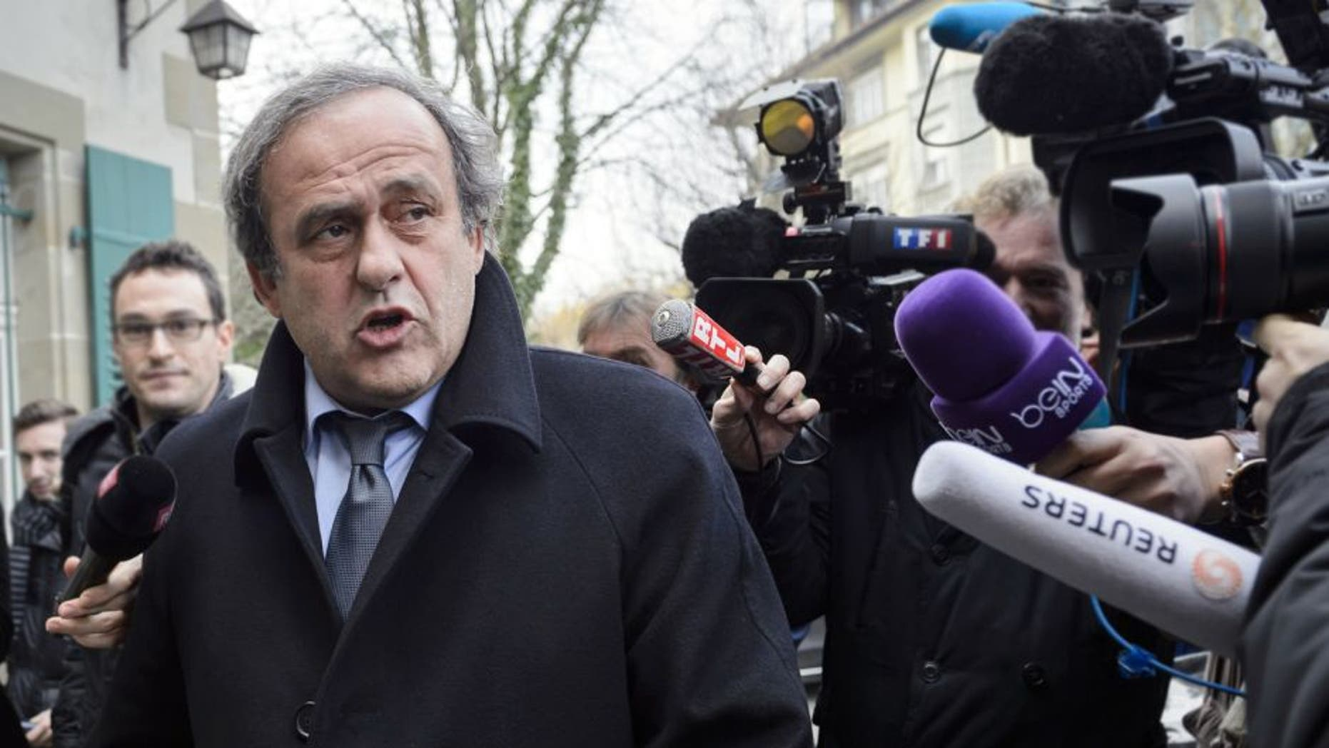 UEFA president and FIFA vice president Michel Platini speaks to the press as he arrives at the Court of Arbitration for Sport (CAS) to appeal against a 90-day suspension in Lausanne on December 8, 2015. The appeal is part of a new campaign by Platini to get back into the election for a new FIFA leader on February 26. / AFP / FABRICE COFFRINI (Photo credit should read FABRICE COFFRINI/AFP/Getty Images)