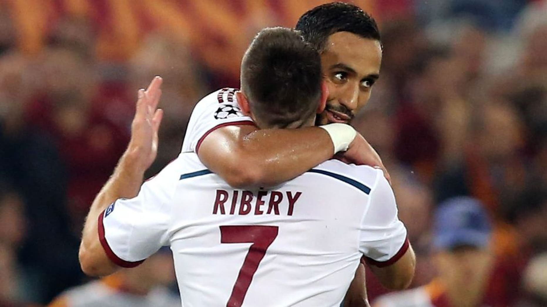 ROME, ITALY - OCTOBER 21: Mehdi Benatia (R) and Franck Ribery of Bayern Muenchen celebrate during the UEFA Champions League match between AS Roma and FC Bayern Munchen at Stadio Olimpico on October 21, 2014 in Rome, Italy (Photo by Maurizio Lagana/Getty Images)