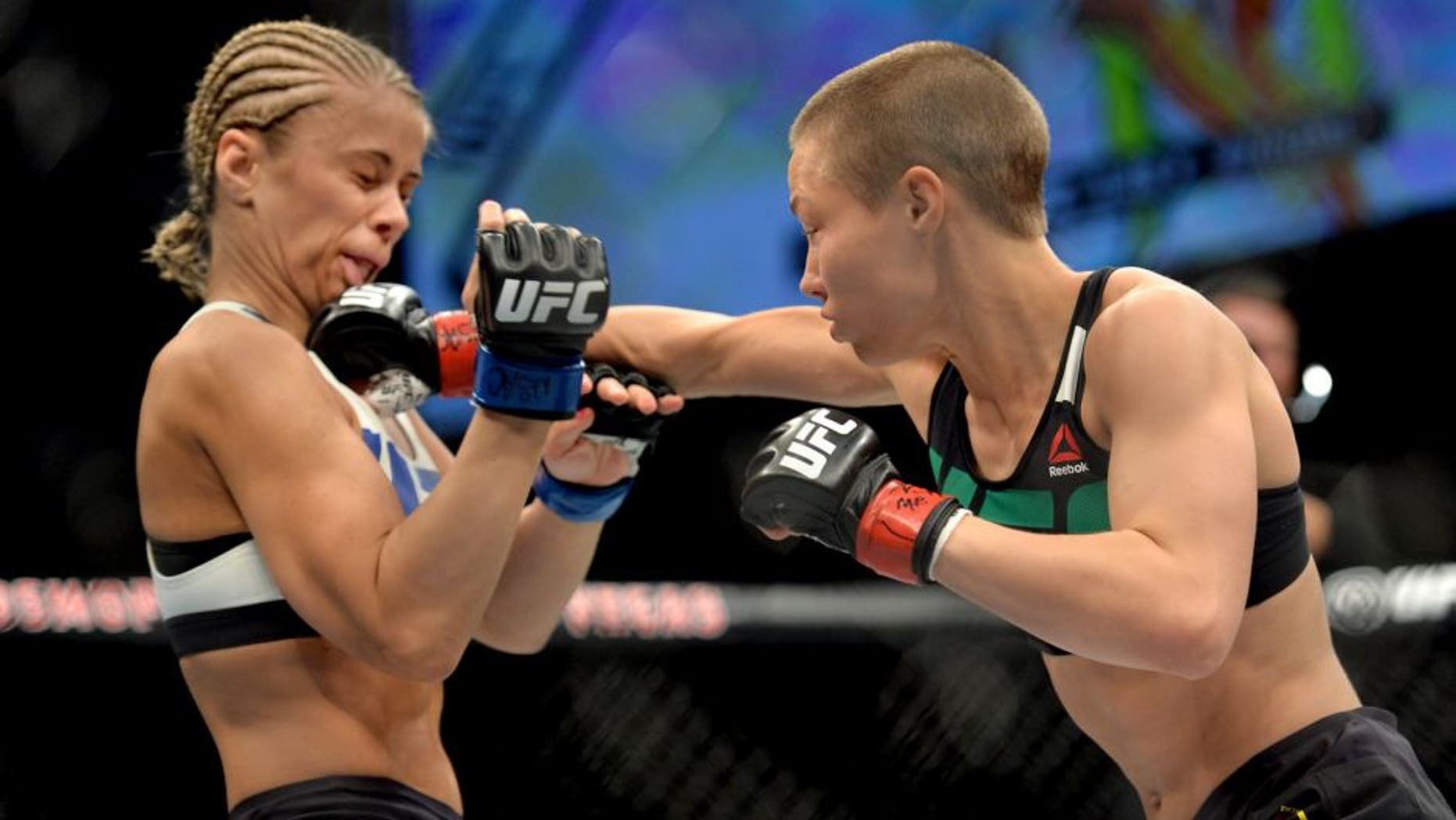 LAS VEGAS, NEVADA - DECEMBER 10: (R) Rose Namajunas punches Paige VanZant in their women's strawweight bout during the UFC Fight Night event at The Chelsea at the Cosmopolitan of Las Vegas on December 10, 2015 in Las Vegas, Nevada. (Photo by Brandon Magnus/Zuffa LLC/Zuffa LLC via Getty Images)