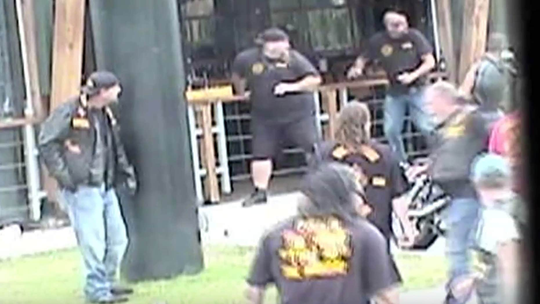 May 17, 2015: In this image made from Texas Department of Public Safety video, bikers run for cover as a shooting erupts outside a Twin Peaks restaurant in Waco, Texas.