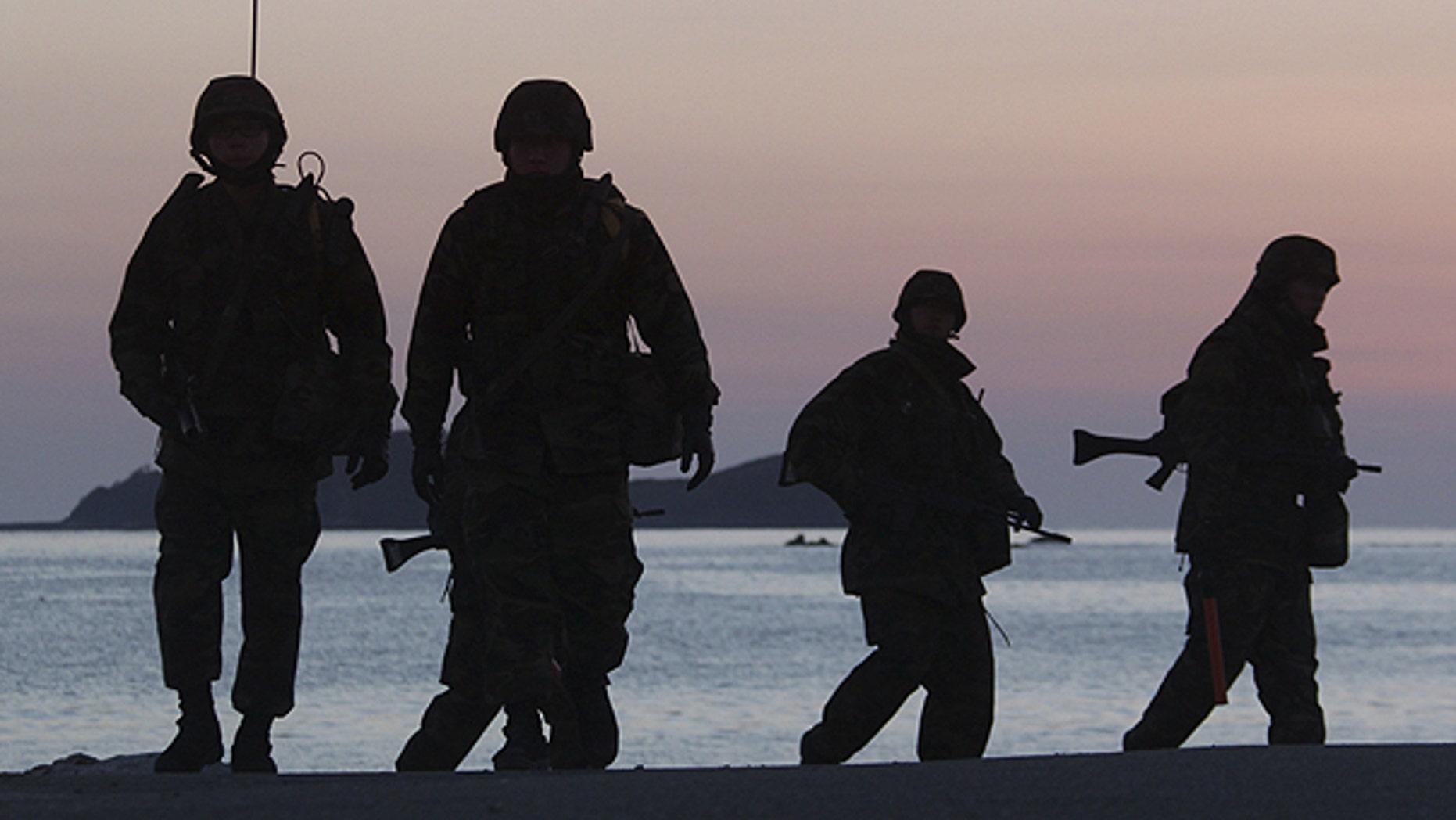Dec. 10: South Korean marines patrol along the beach of Yeonpyeong Island, South Korea.