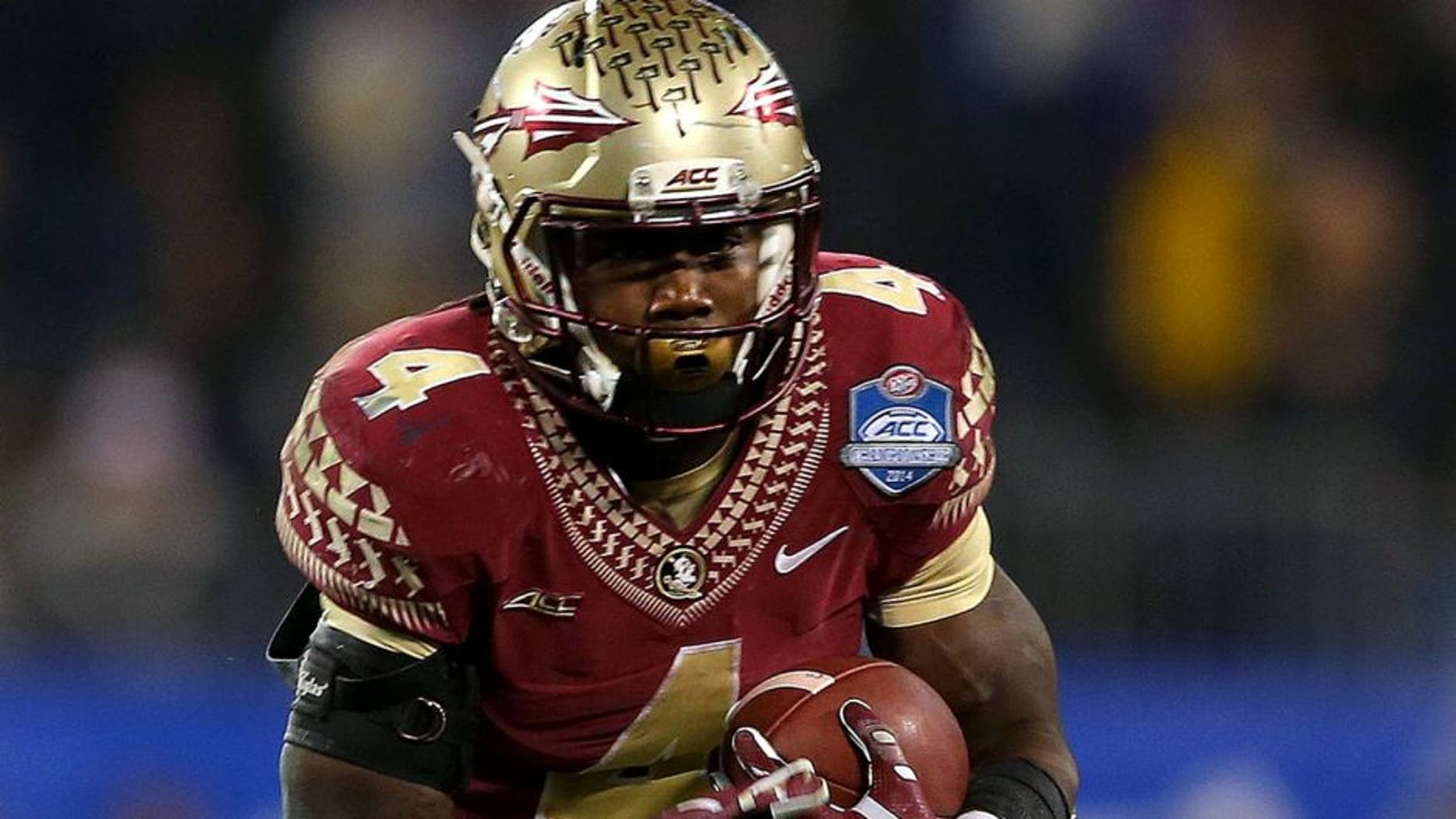 CHARLOTTE, NC - DECEMBER 06: Dalvin Cook #4 of the Florida State Seminoles runs the ball against the Georgia Tech Yellow Jackets in the 3rd quarter during the ACC Championship game on December 6, 2014 in Charlotte, North Carolina. (Photo by Mike Ehrmann/Getty Images)