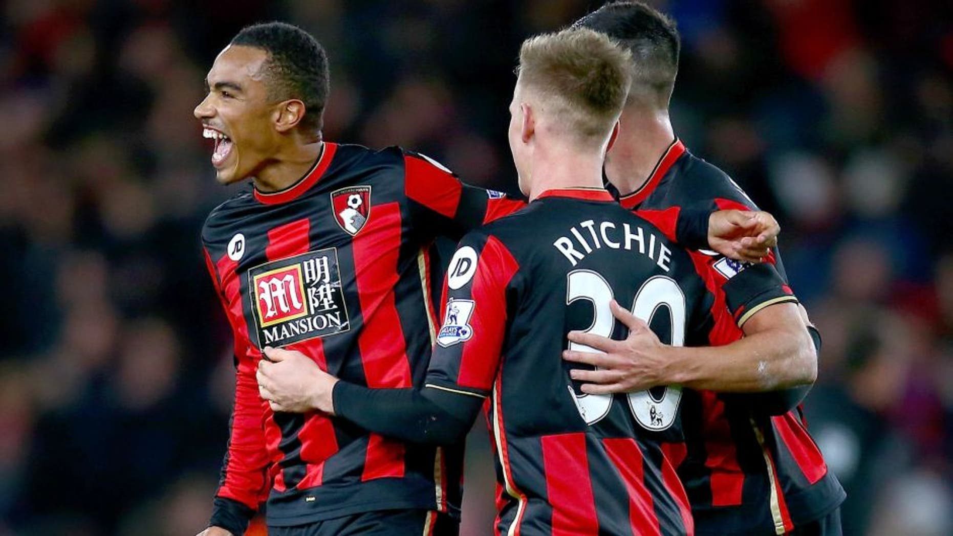 BOURNEMOUTH, ENGLAND - DECEMBER 12: Matt Ritchie, Junior Stanislas and Andrew Surman of Bournemouth celebrate after the final whistle in the Barclays Premier League match between A.F.C. Bournemouth and Manchester United at Vitality Stadium on December 12, 2015 in Bournemouth, United Kingdom. (Photo by Jordan Mansfield/Getty Images)