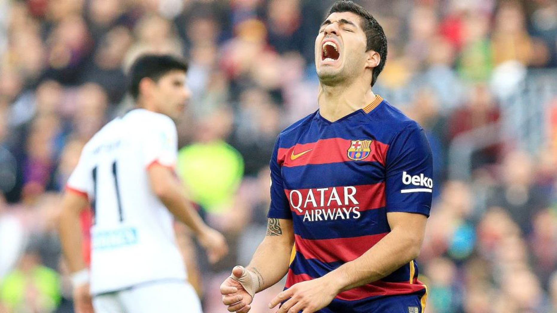 FC Barcelona's Uruguayan forward Luis Suarez shouts during the Spanish league football match FC Barcelona vs RC Deportivo La Coruna at the Camp Nou stadium in Barcelona on December 12, 2015. AFP PHOTO / PAU BARRENA / AFP / PAU BARRENA (Photo credit should read PAU BARRENA/AFP/Getty Images)