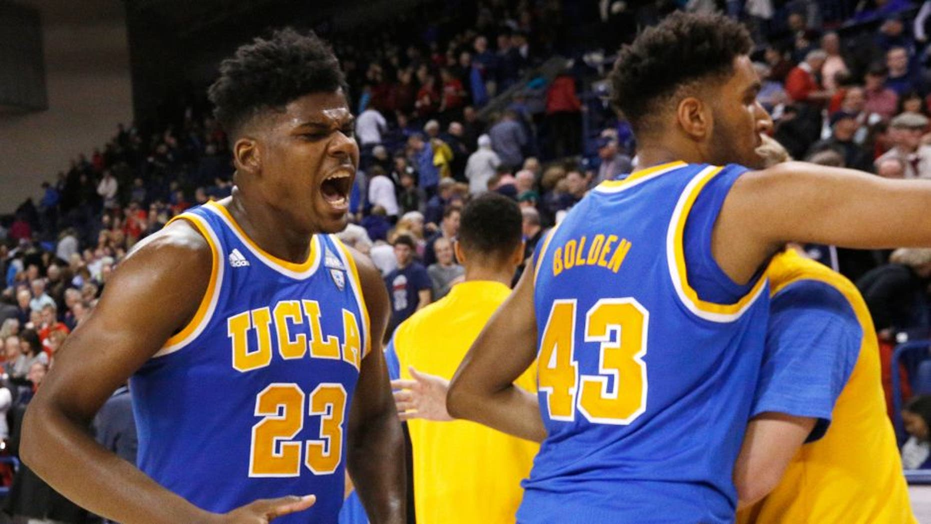 UCLA's Tony Parker (23) celebrates after an NCAA college basketball game against Gonzaga, Saturday, Dec. 12, 2015, in Spokane, Wash. UCLA won 71-66. (AP Photo/Young Kwak)