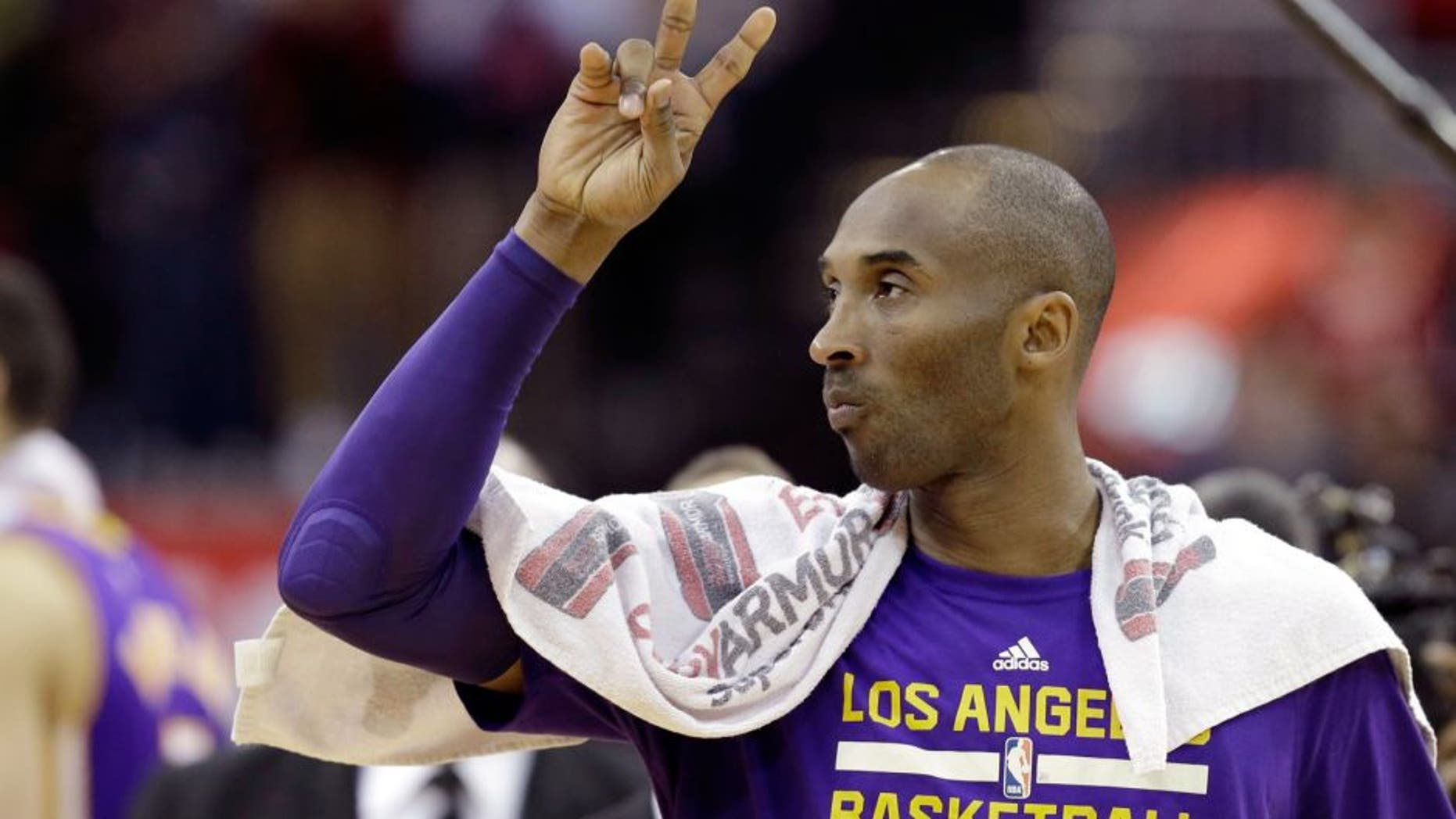 Los Angeles Lakers' Kobe Bryant acknowledges the fans as he leaves the court after an NBA basketball game against the Houston Rockets Saturday, Dec. 12, 2015, in Houston. The Rockets won 126-97. (AP Photo/Pat Sullivan)