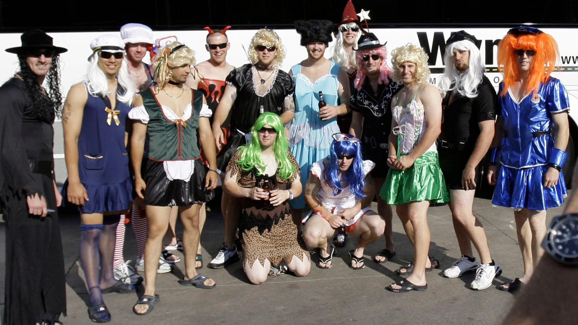 FILE - In this Sept. 24, 2008, file photo, Oakland Athletics rookie players dressed in costumes line up for a group photo before boarding the team bus after their 14-4 loss to the Texas Rangers, in Arlington, Texas.