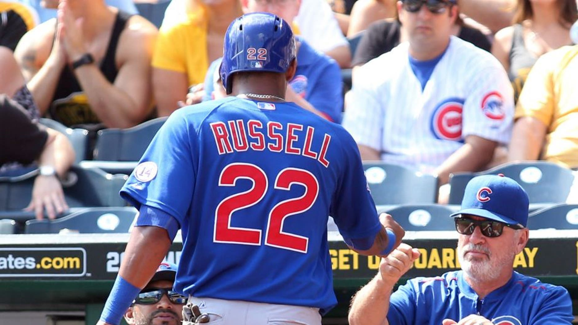 Sep 17, 2015; Pittsburgh, PA, USA; Chicago Cubs manager Joe Maddon (R) greets shortstop Addison Russell (22) after Russell scored a run against the Pittsburgh Pirates during the second inning at PNC Park. Mandatory Credit: Charles LeClaire-USA TODAY Sports