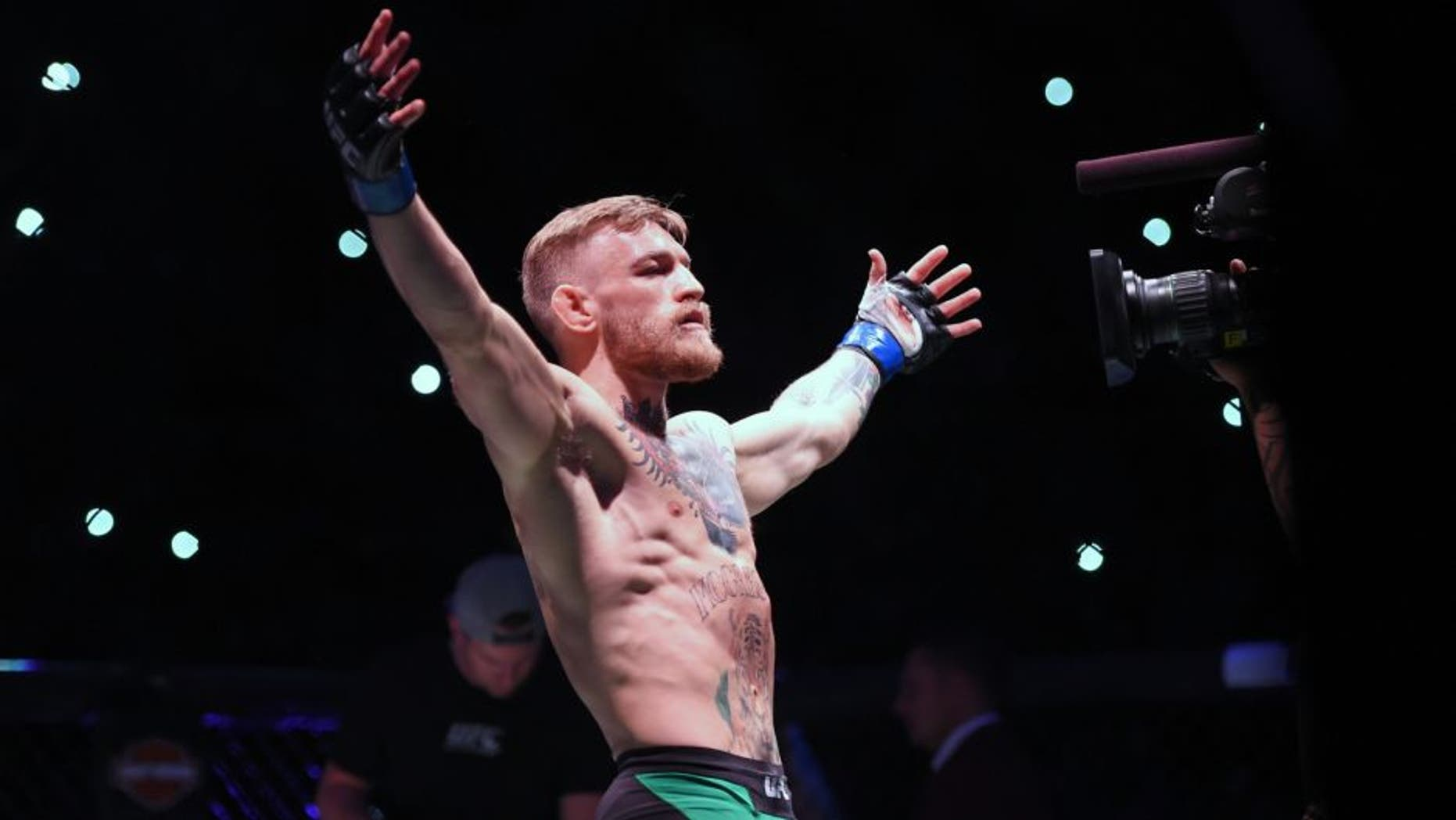 LAS VEGAS, NEVADA - DECEMBER 12: Conor McGregor of Ireland is introduced to the crowd before facing Jose Aldo of Brazil in their featherweight championship bout during the UFC 194 event inside MGM Grand Garden Arena on December 12, 2015 in Las Vegas, Nevada. (Photo by Jeff Bottari/Zuffa LLC/Zuffa LLC via Getty Images)