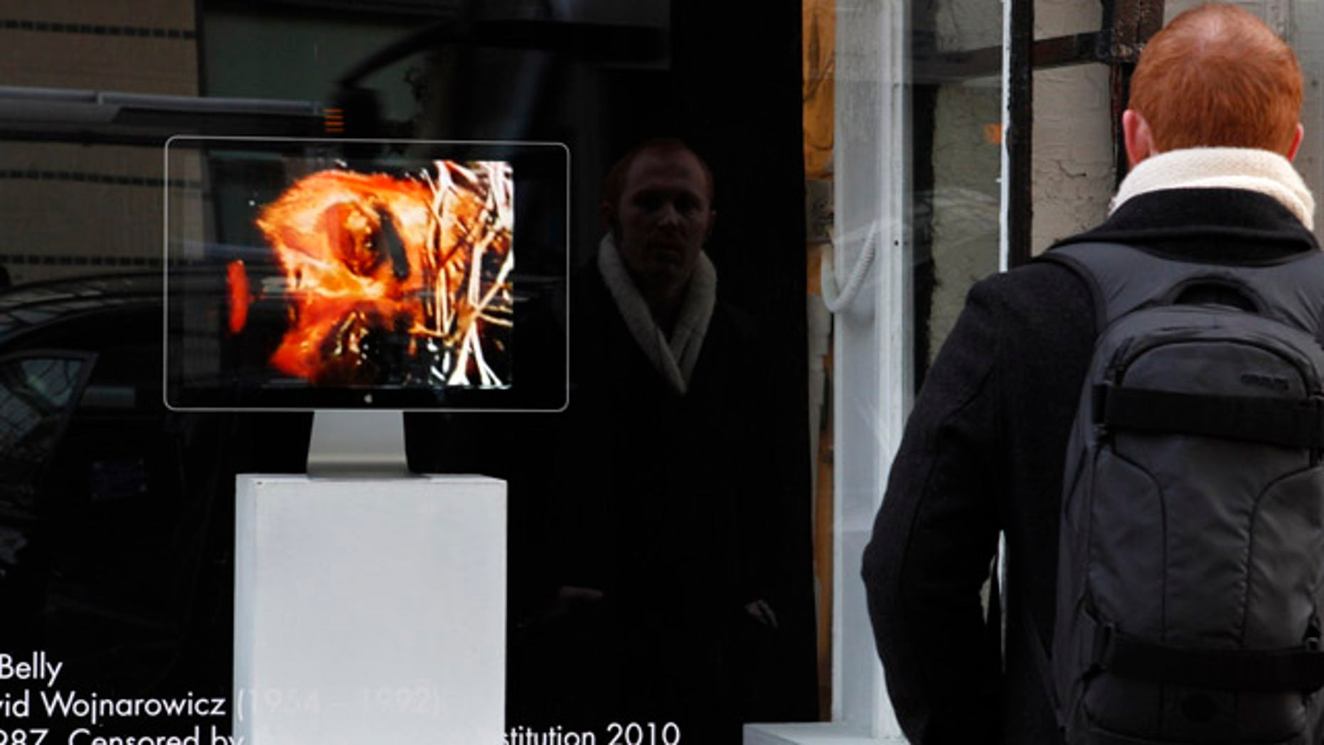 """Dec. 2: A man watches the video, """"A Fire in My Belly"""" outside the Transformer Gallery in Washington."""