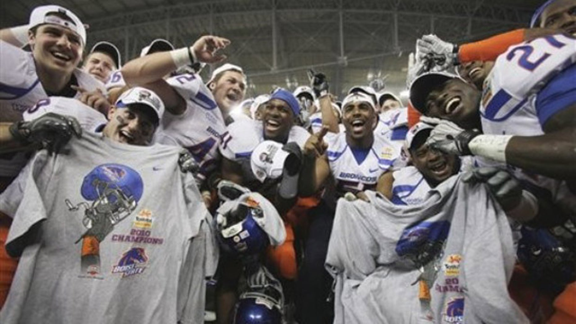 Boise State players celebrate their victory over TCU after the Fiesta Bowl NCAA college football game Monday, Jan. 4, 2010, in Glendale, Ariz.