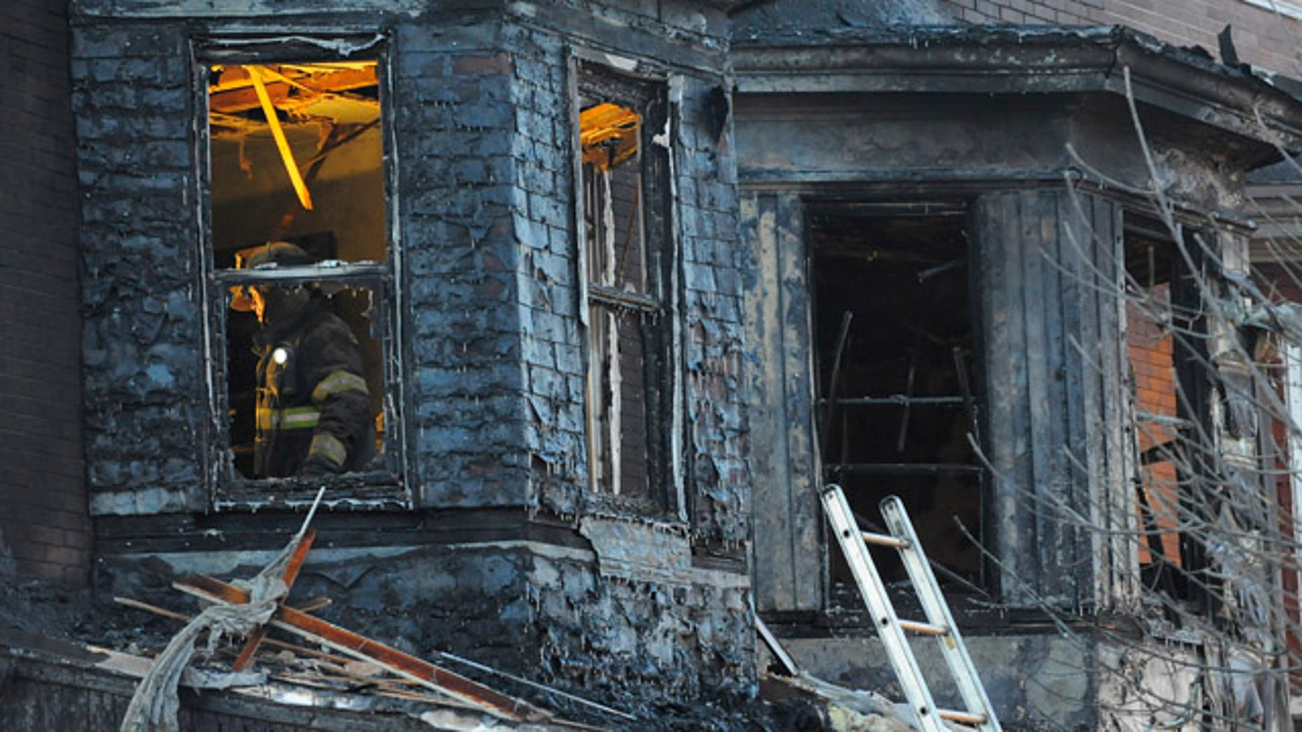 Dec. 14: Firefighters investigate the scene of an early morning two-alarm fire in the 2300 block of Homewood Ave. in East Baltimore.