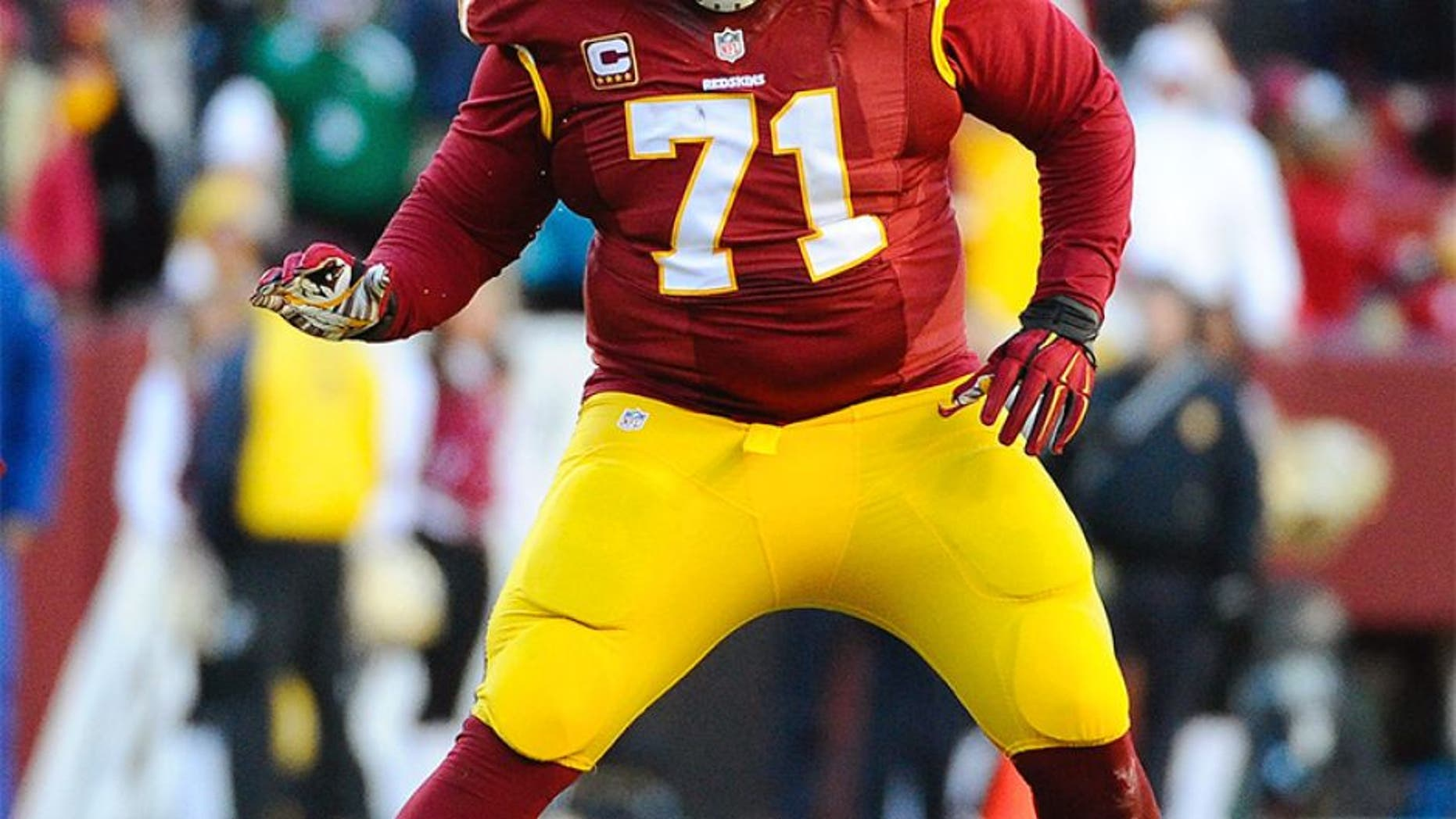 Dec 7, 2014; Landover, MD, USA; Washington Redskins tackle Trent Williams (71) prepares to block against the St. Louis Rams during the second half at FedEx Field. Mandatory Credit: Brad Mills-USA TODAY Sports