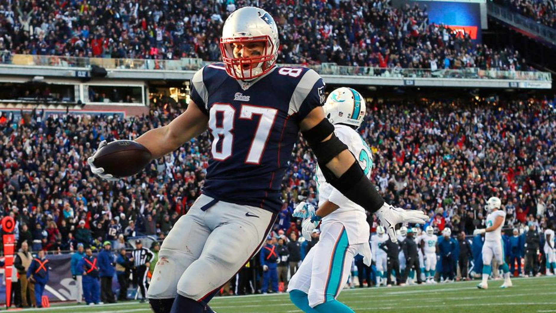 Dec 14, 2014; Foxborough, MA, USA; New England Patriots tight end Rob Gronkowski (87) scores a touchdown during the second half against the Miami Dolphins at Gillette Stadium. The Patriots won 41-13. Mandatory Credit: Winslow Townson-USA TODAY Sports
