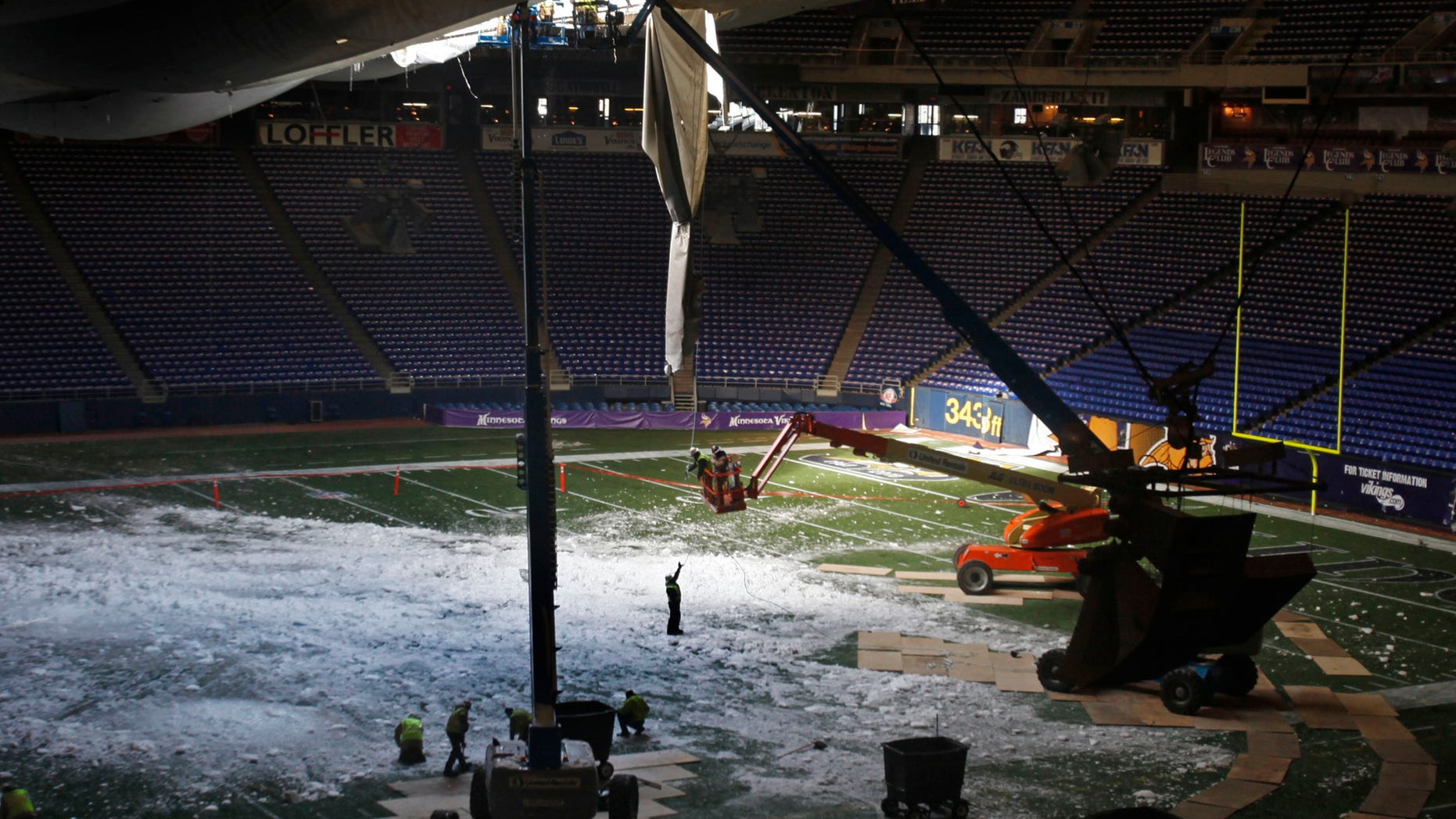 Dec. 14: Workers tend to the torn roof of the Metrodome in Minneapolis.