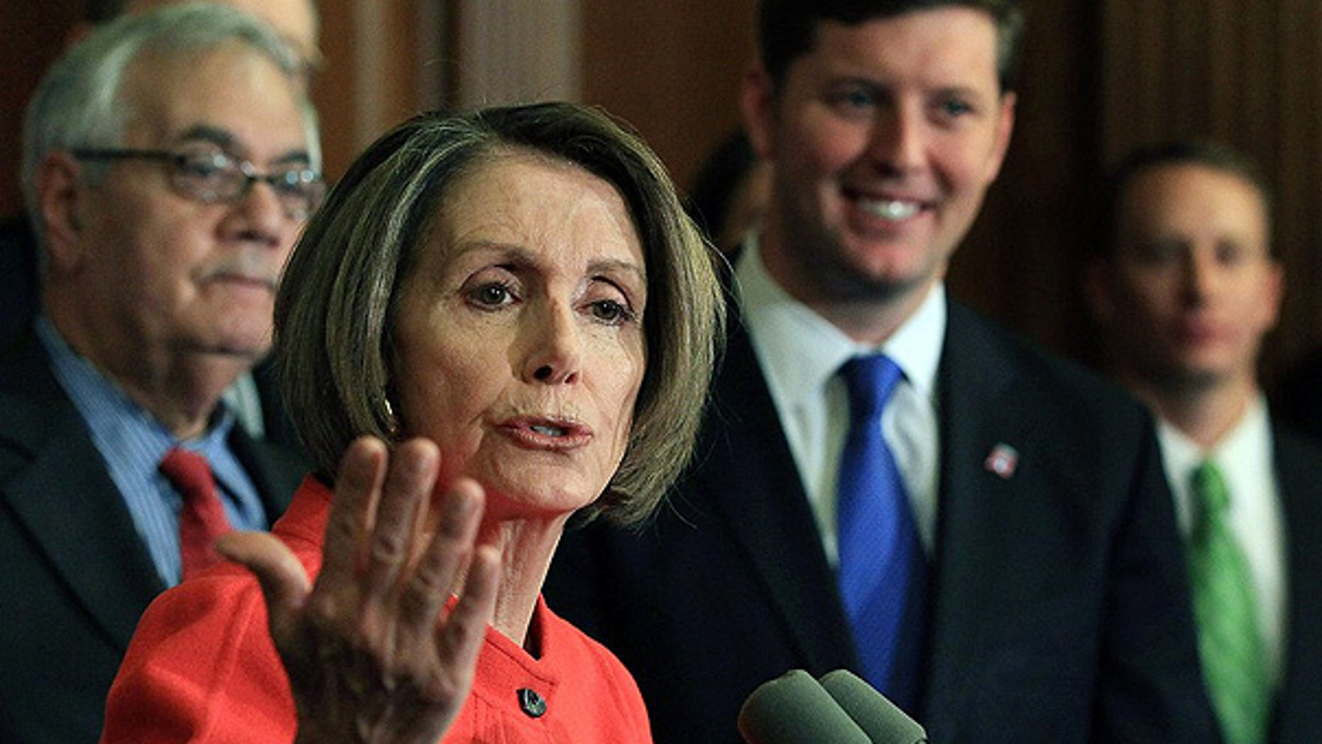 Dec. 15: House Speaker Nancy Pelosi is flanked by Rep. Barney Frank, left, and Rep. Patrick Murphy during a news conference on Capitol Hill.