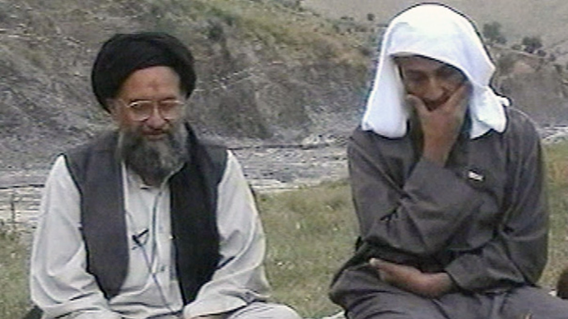 Al Qaeda chief Usama bin Laden, right, listens to his top deputy Ayman al-Zawahri speaking at an undisclosed location.