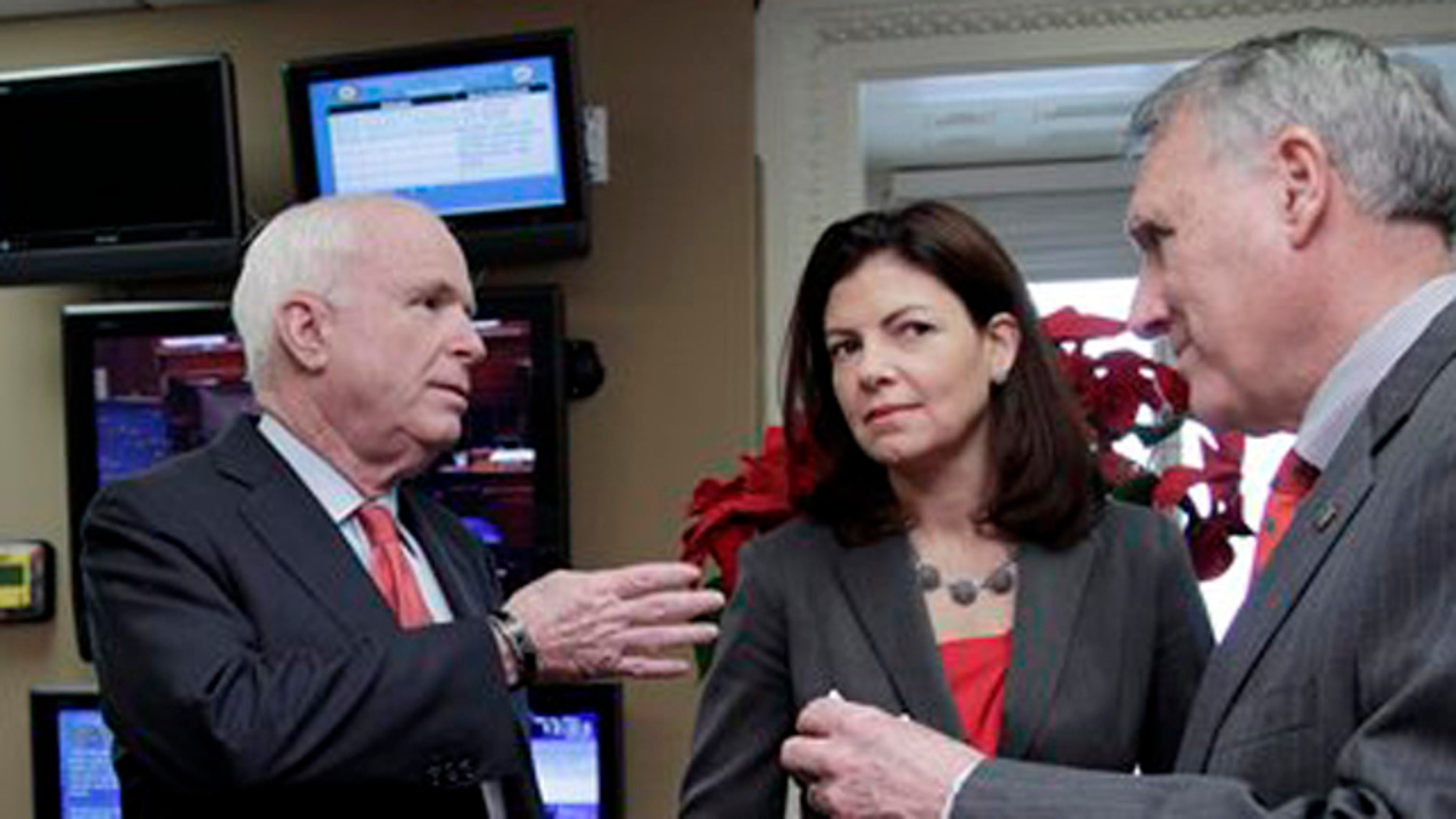 December 14, 2011: Senate Minority Whip Jon Kyl of Ariz., Sen. Kelly Ayotte, R-N.H., and Sen. John McCain, R-Ariz.,  ranking Republican on the Senate Armed Services Committee, confer before a news conference on Capitol Hill in Washington.