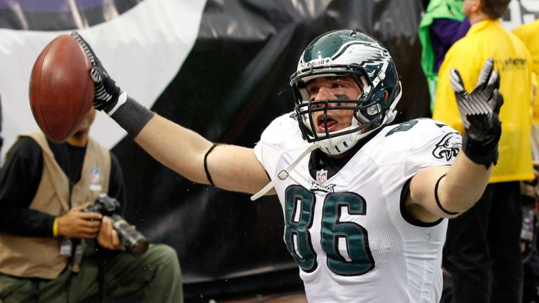 Philadelphia Eagles tight end Zach Ertz reacts after catching a 3-yard touchdown pass during the second half of an NFL football game against the Minnesota Vikings, Sunday, Dec. 15, 2013, in Minneapolis. (AP Photo/Ann Heisenfelt)