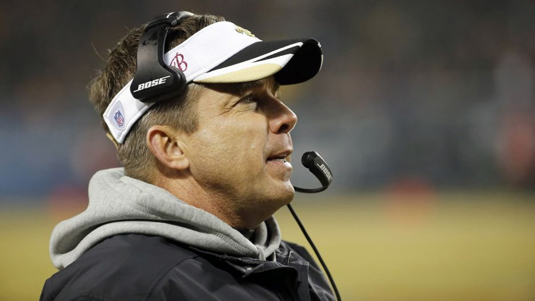 New Orleans Saints head coach Sean Payton watches from the sideline during the first half of an NFL football game against the Chicago Bears Monday, Dec. 15, 2014, in Chicago. (AP Photo/Charles Rex Arbogast)