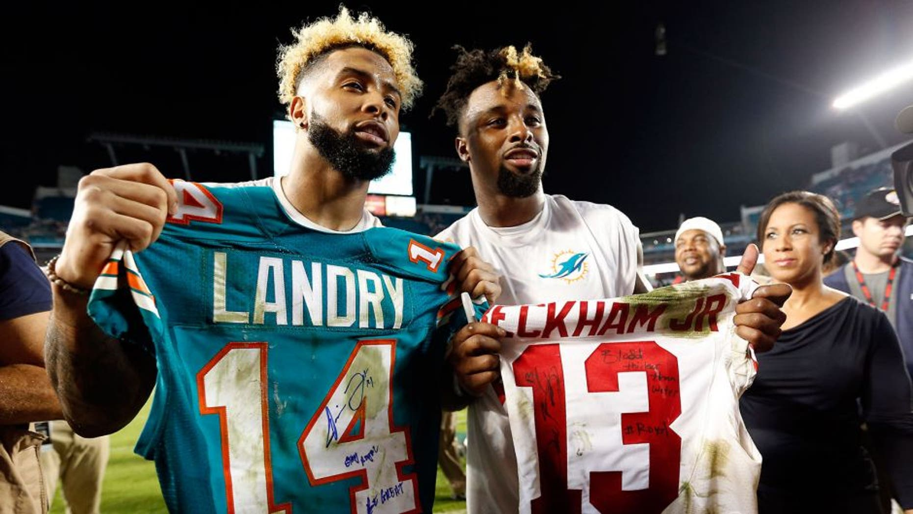 Dec 14, 2015; Miami Gardens, FL, USA; Miami Dolphins wide receiver Jarvis Landry (14) and New York Giants wide receiver Odell Beckham Jr. (13) both display their signed jersey's after their game at Sun Life Stadium. Mandatory Credit: Steve Mitchell-USA TODAY Sports